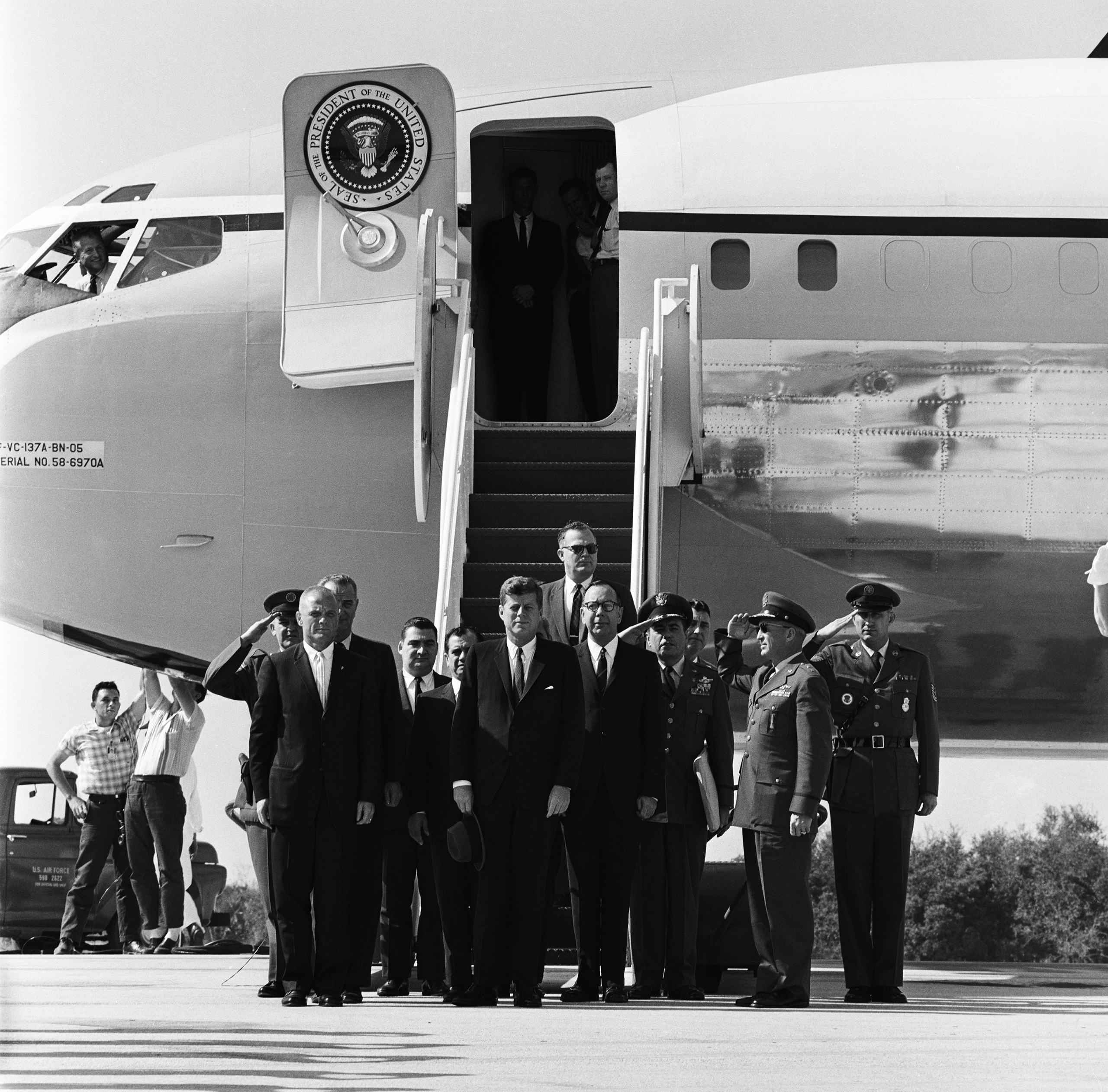 <b>A Presidential Tribute</b> On Feb. 23, 1962, three days after the successful mission, President Kennedy and Vice President Johnson visit Cape Canaveral, Fla., to present Glenn with NASA's Distinguished Service Medal. (Johnson is visible just behind Glenn at left.)