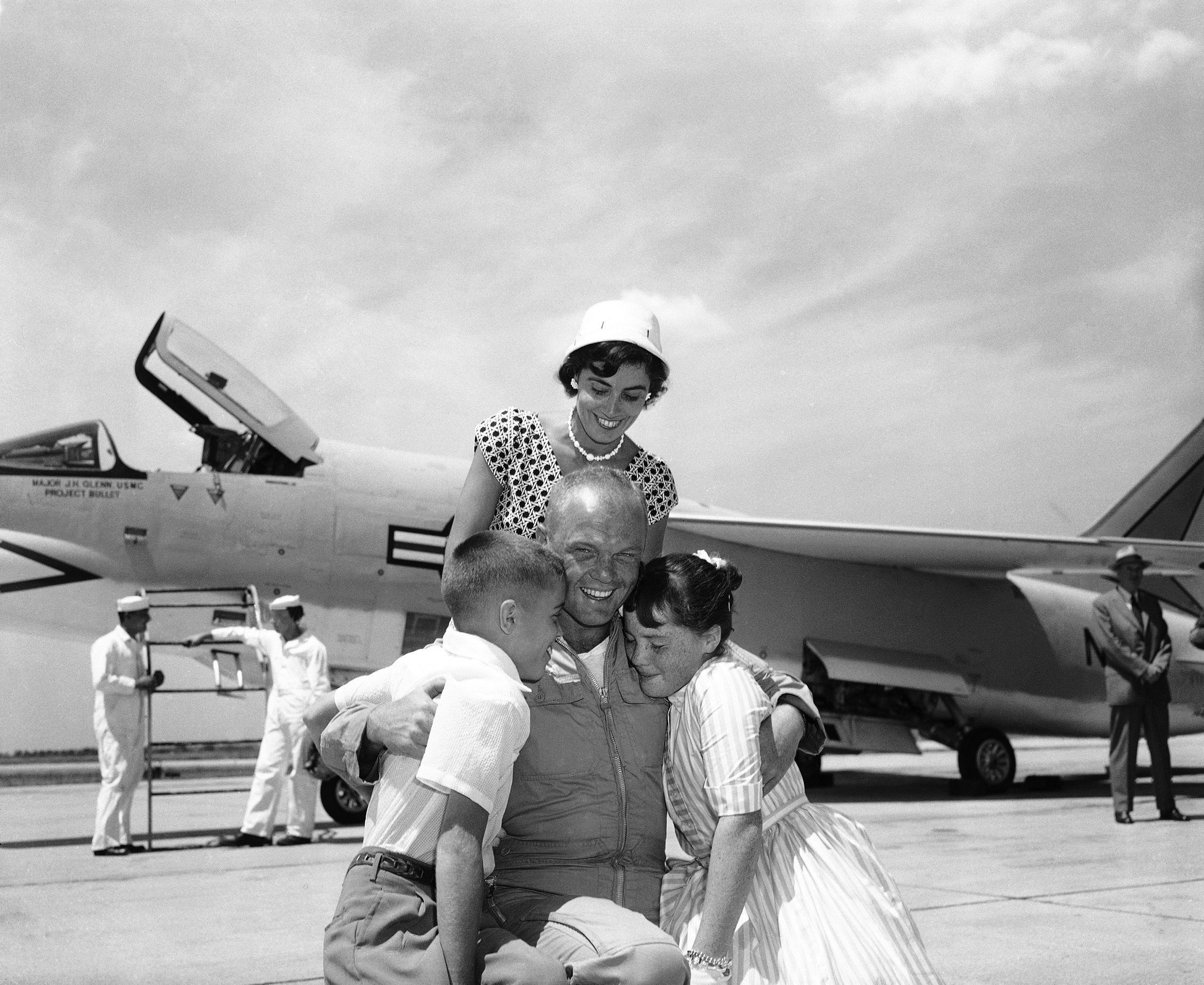 <b>Family Reunion</b> Glenn, greeted here by his wife Anne and his children Dave and Lyn, had just completed a flight from California to New York in 3 hr., 23 min., 8.4 sec., beating the previous record by more than 21 minutes. The date was July 16, 1957. No American had yet flown in space; 12 years later to the day, Apollo 11 would lift off for the first lunar landing.