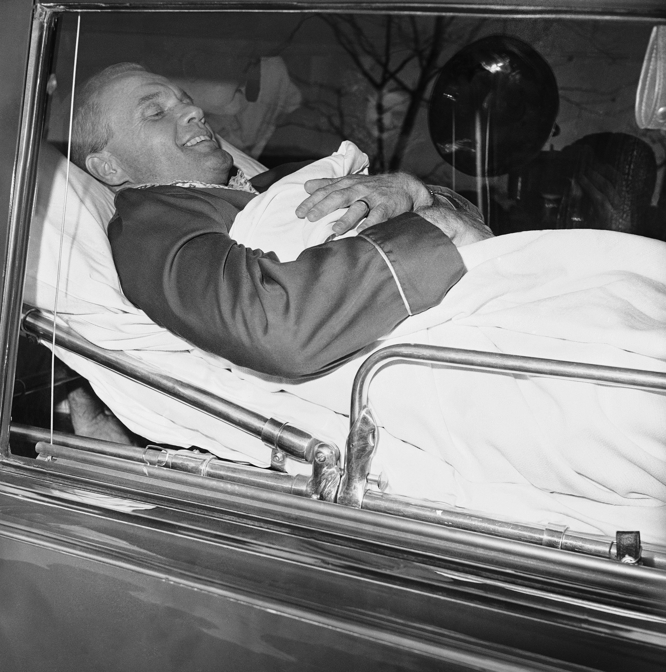<b>A Medical Mission</b> In an ambulance in Ohio, Glenn prepares to be flown to Lackland Air Force Base in Texas for further treatment of his inner-ear injury in 1964.