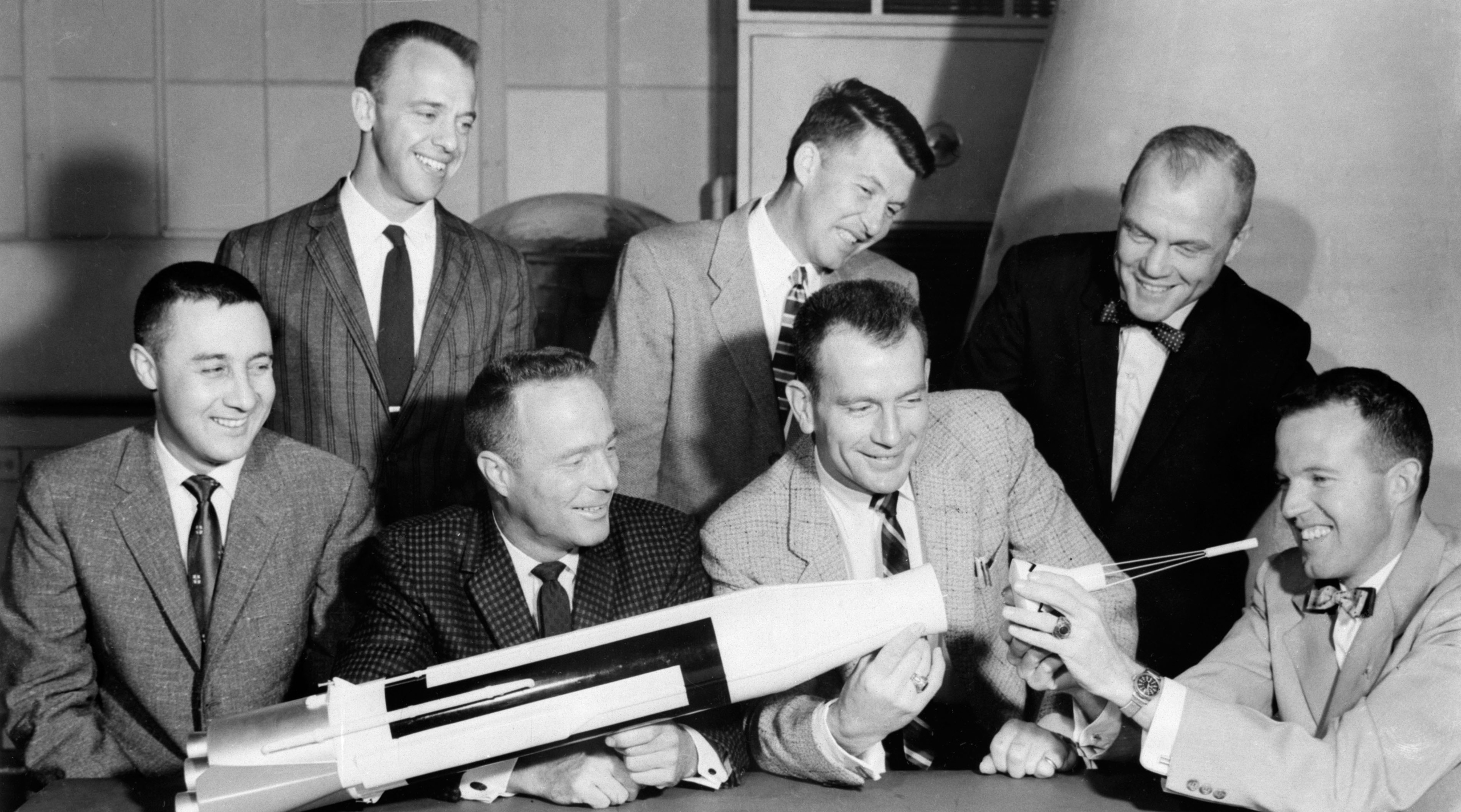<b>The Magnificent Seven</b>                                   The original seven Mercury astronauts examine a rough model of the Mercury-Atlas rocket in 1959. Back row, from left: Al Shepard, Wally Schirra and John Glenn; front row, from left: Gus Grissom, Scott Carpenter, Deke Slayton and Gordon Cooper.