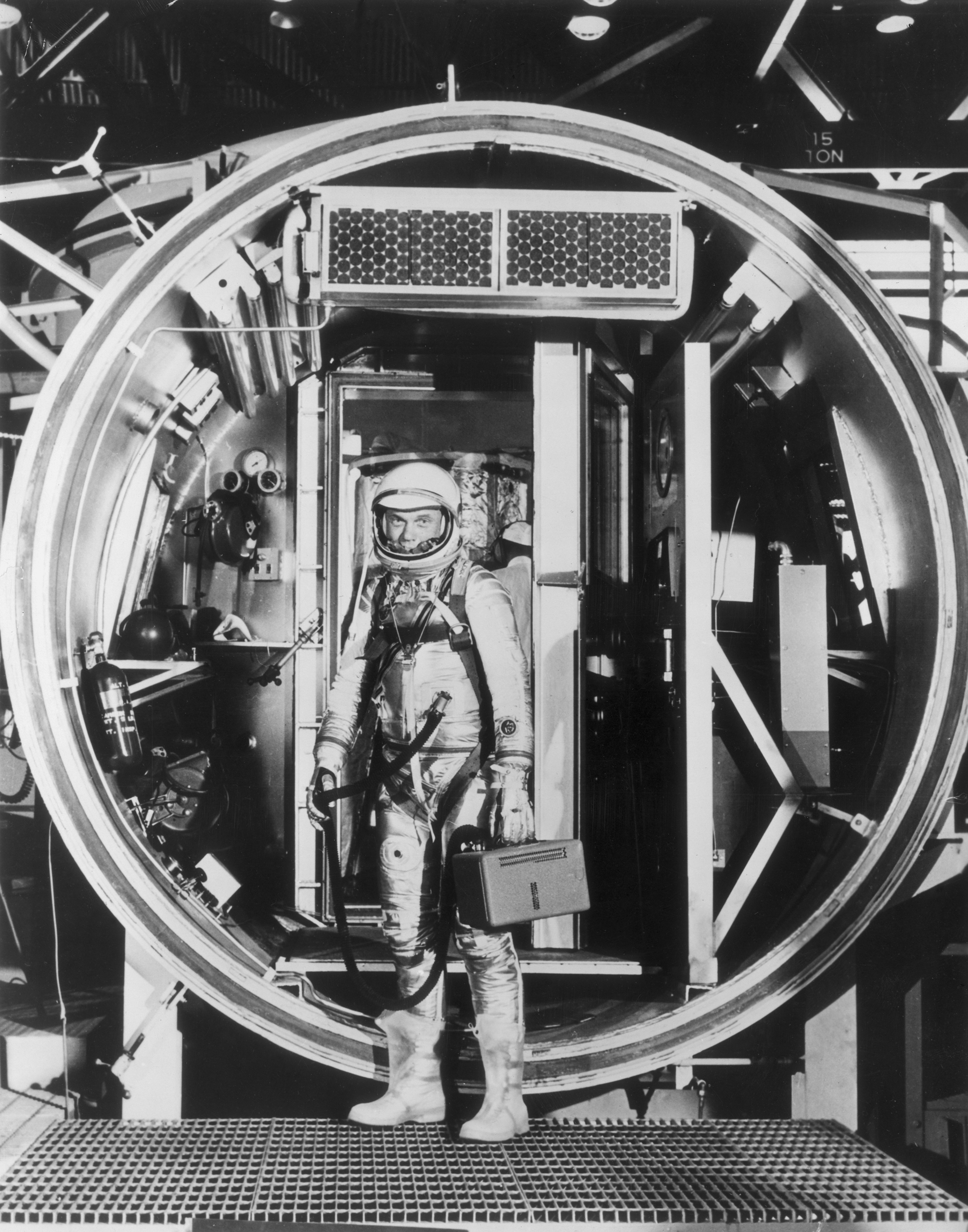 <b>High-Tech Testing</b> Glenn, in 1962, in a fully pressurized suit, prepares to enter an altitude chamber, which simulates air pressure at various stages of flight.