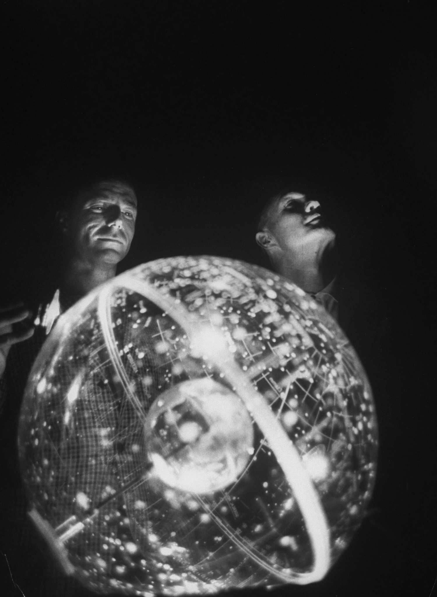 Celestial Ambitions Scott Carpenter, left, and Glenn study the three-dimensional celestial trainer in 1961.