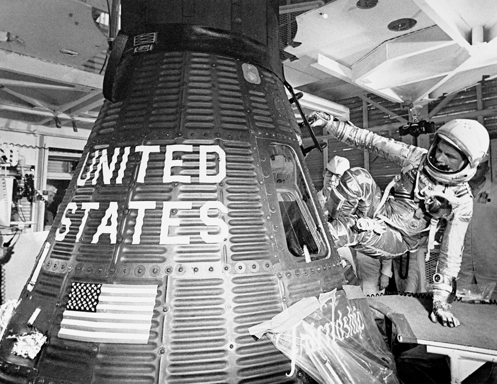 John Glenn boards the Friendship 7 capsule to become the first American to orbit the earth, during the Mercury-Atlas 6) mission, on Feb. 20, 1962. A temporary handle bolted to the outside of the spacecraft made the clumsy maneuver a little easier.
