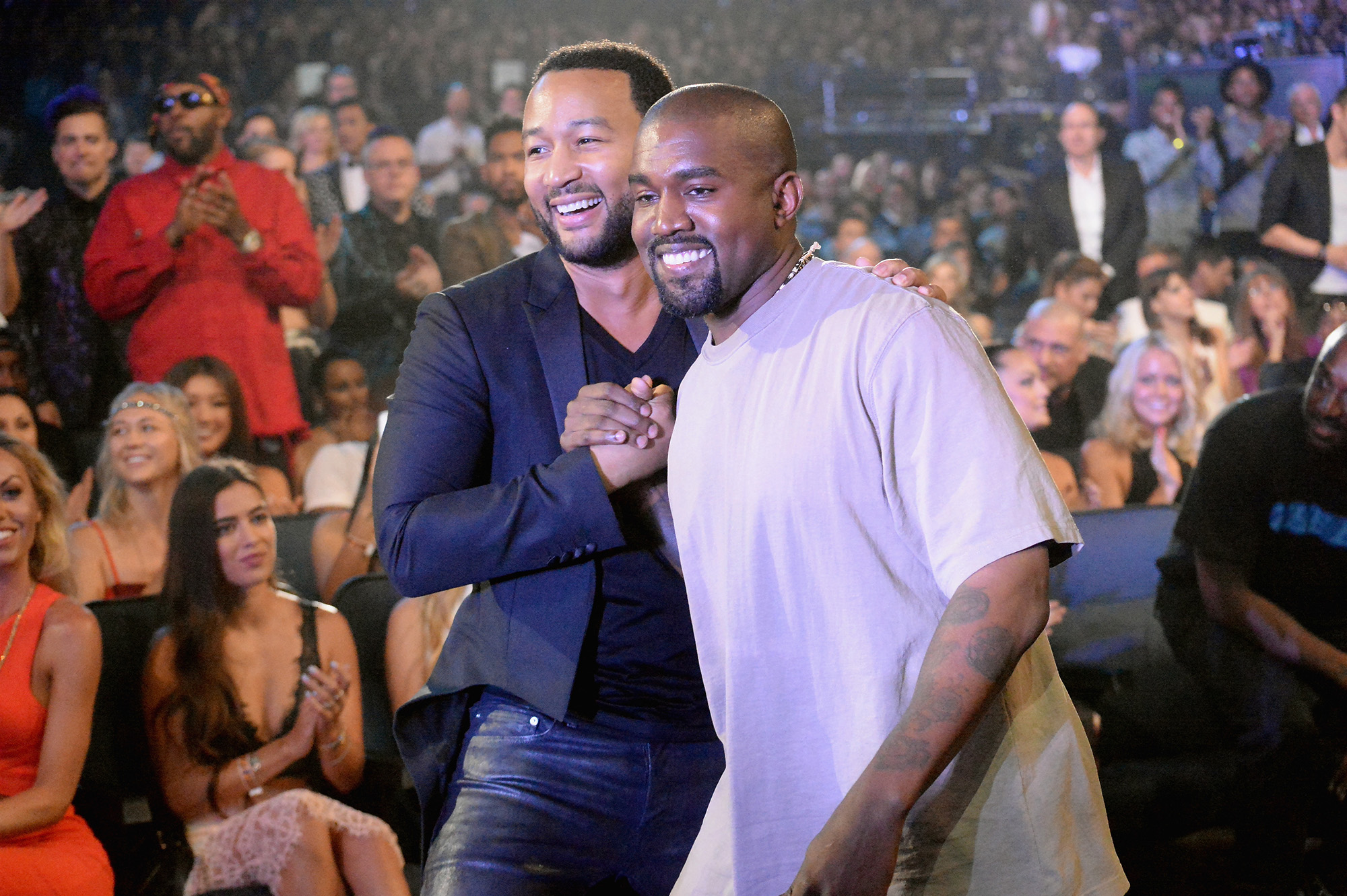 John Legend and Kanye West attend the 2015 MTV Video Music Awards in Los Angeles, California.  (Photo by Jeff Kravitz/MTV1415/FilmMagic)