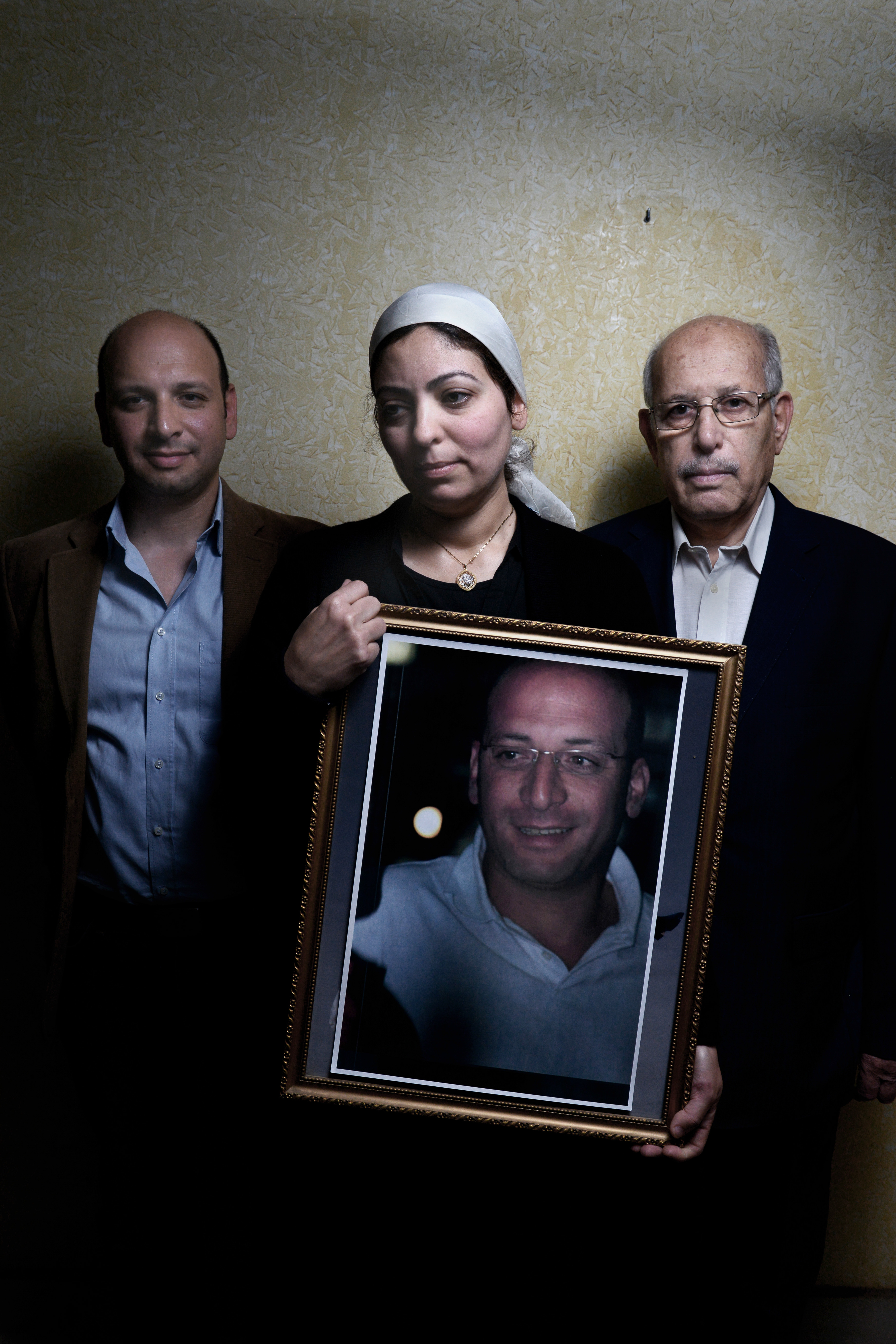 Hazem Helal, Eman Samy and Mohamed Helal, the brother, wife and father of passenger Ahmed HelalFrom  The Losses of EgyptAir Flight 804.