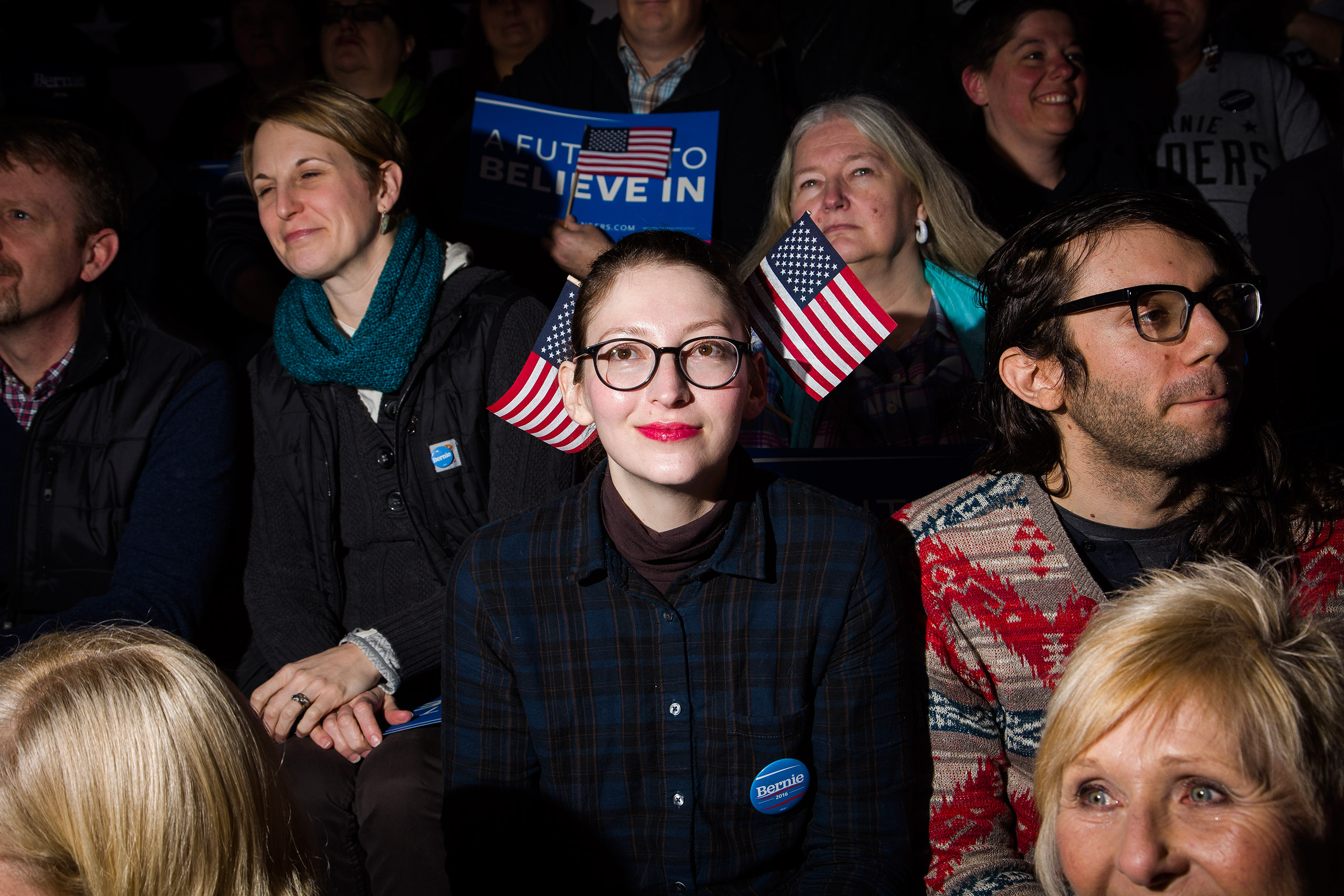 Anjuli Willmer sports double flags at a New Hampshire primary night rally for Democratic presidential candidate, Vermont Sen. Bernie Sanders at Concord High School on Tuesday, Feb. 9, 2016, in Concord, N.H.From  Chasing the Flag in New Hampshire