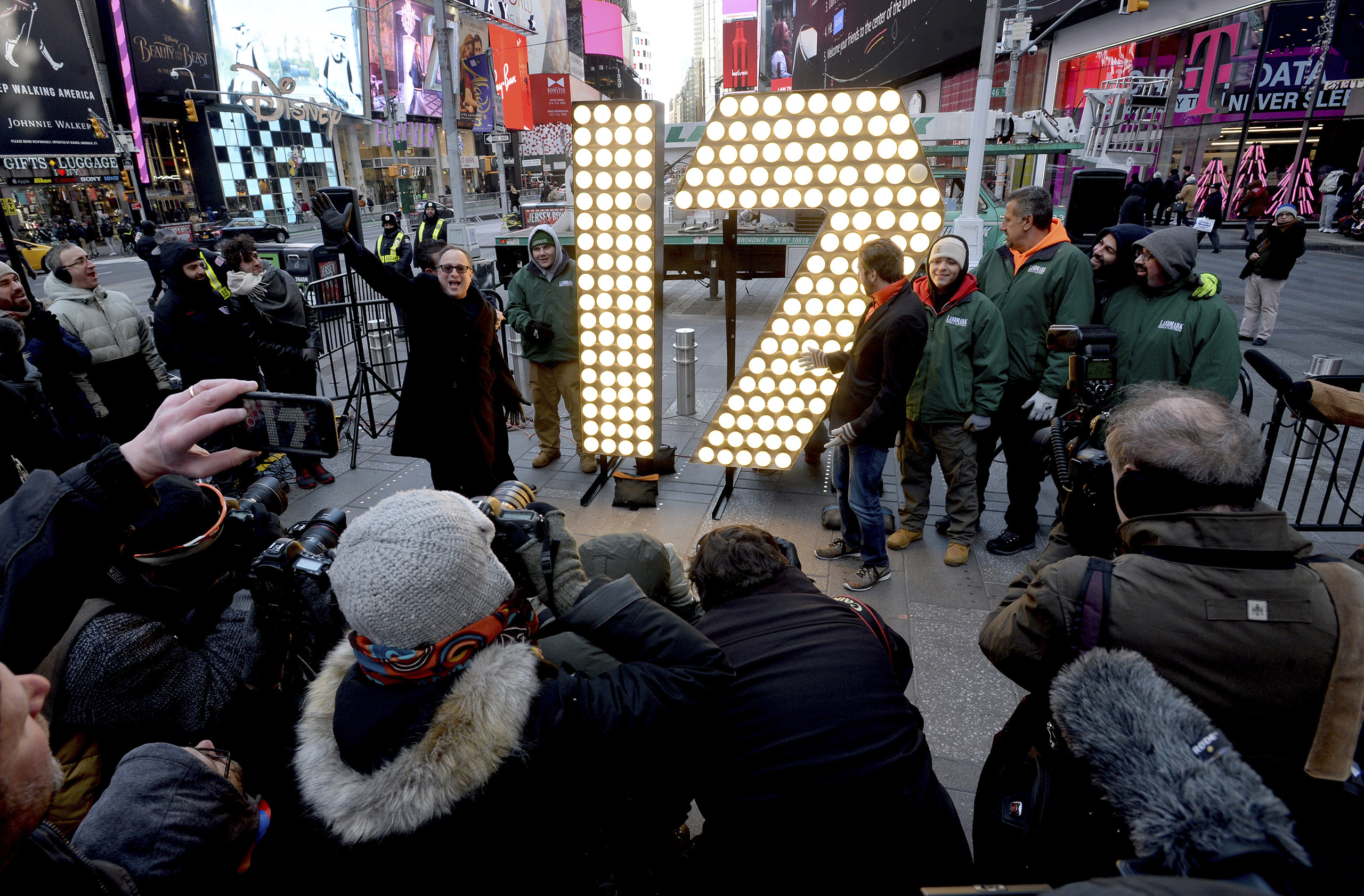 The numerals '1' and '7,' to be used to spell out '2-0-1-7' for the Times Square New Years Eve celebration, are unloaded from a flatbed truck before being unveiled in Times Square in New York City, on Dec. 15, 2016.