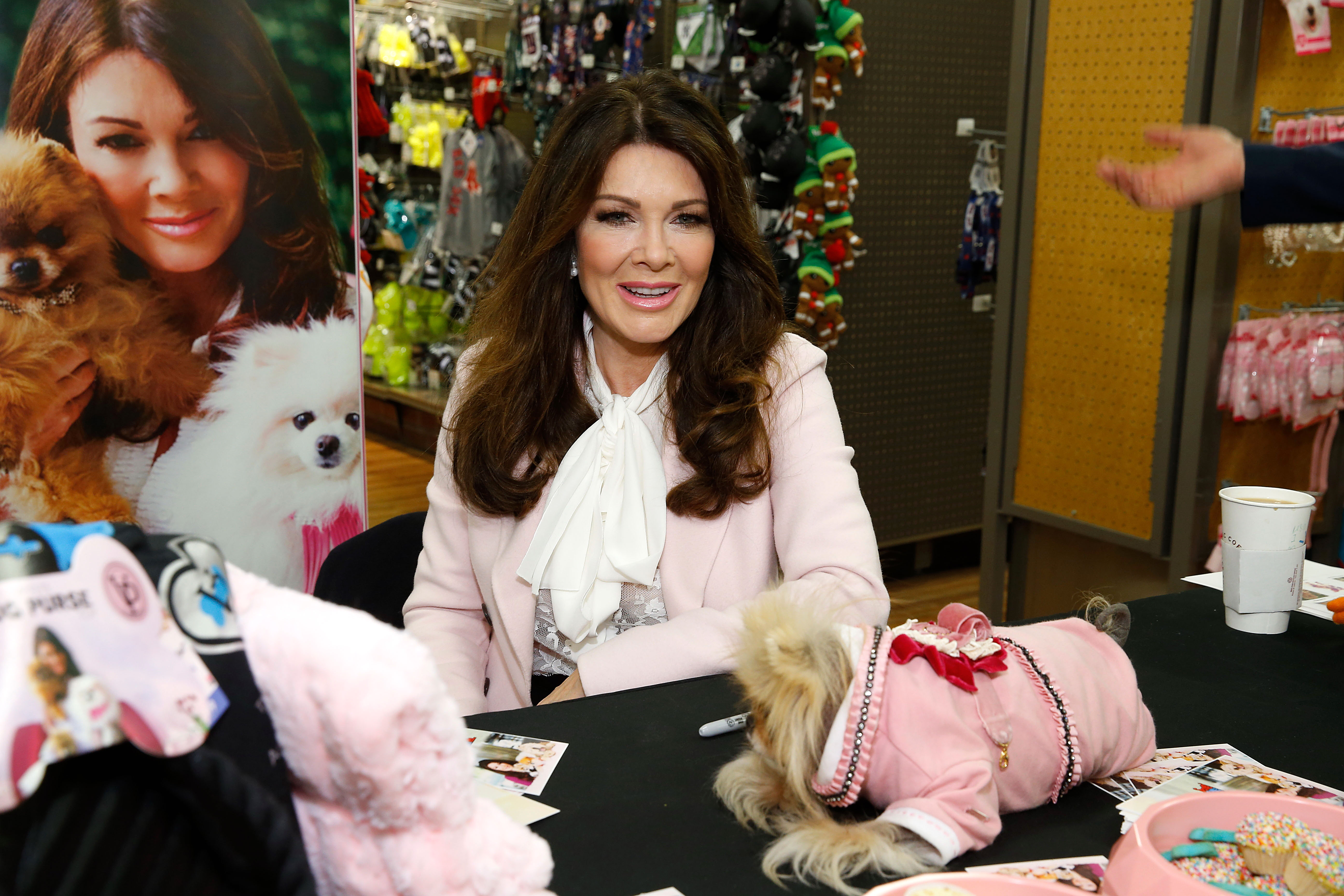 Lisa Vanderpump  and her dog Giggy attend Vanderpump Pets Launch at Petco Union Square on December 8, 2016 in New York City.