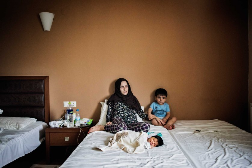 Taimaa Abazli, 24, with her newborn daughter, Heln, born by C-section on Sept. 13 at a hotel outside Thessaloniki, Greece. Her first child, Wael, sits with them. Taimaa and her husband, Muhannad 28, are from Idlib, Syria, near the border with Turkey, Sept. 19, 2016.