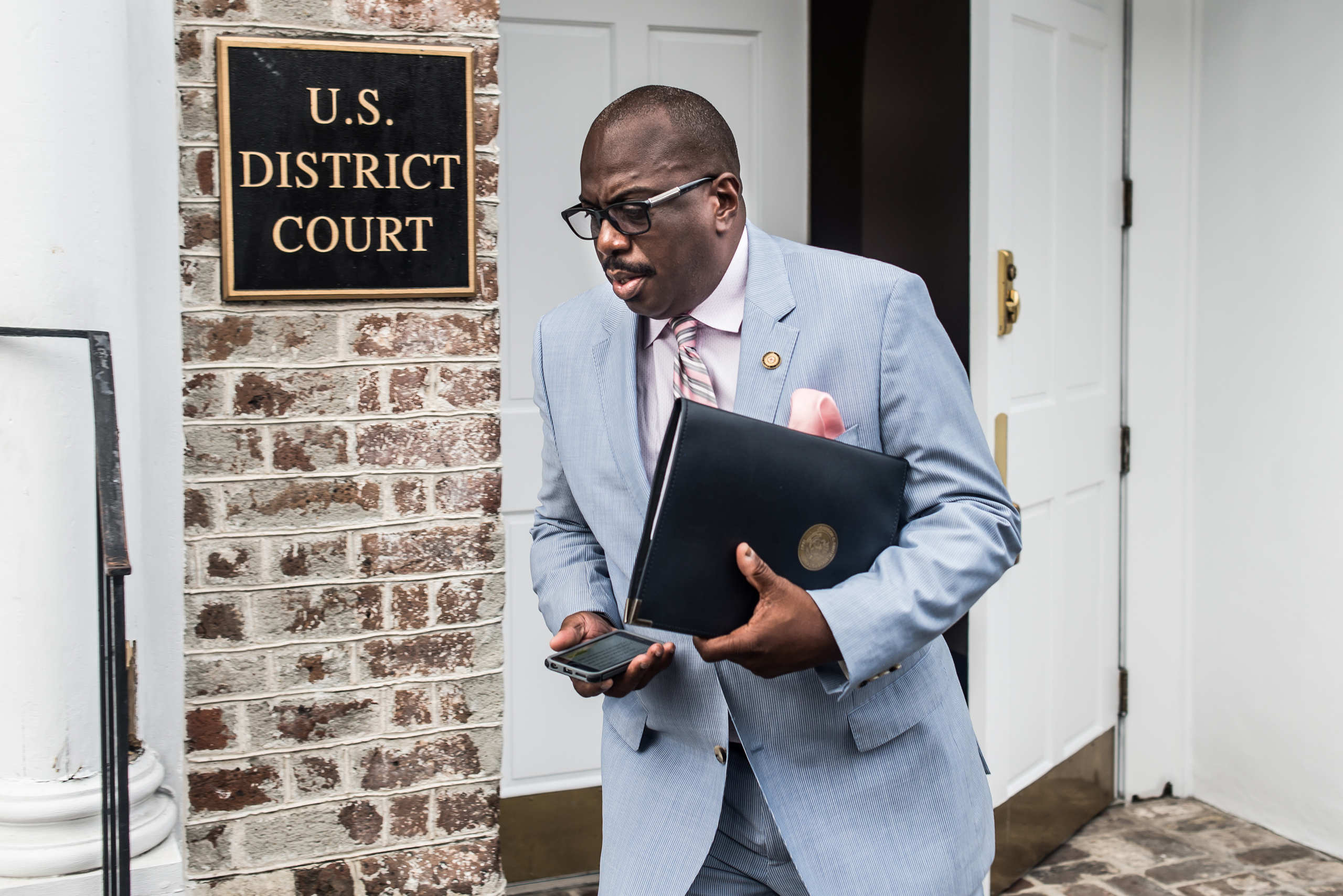 Malcolm Graham, a North Carolina State Senator and brother of Cynthia Hurd, exits a federal court building prior to arraignment hearings for Dylann Roof in Charleston, South Carolina on July 31, 2015. Roof, the shooter involved in the June 17 massacre at Emanuel AME Church in Charleston faces 33 federal charges of federal hate crimes.