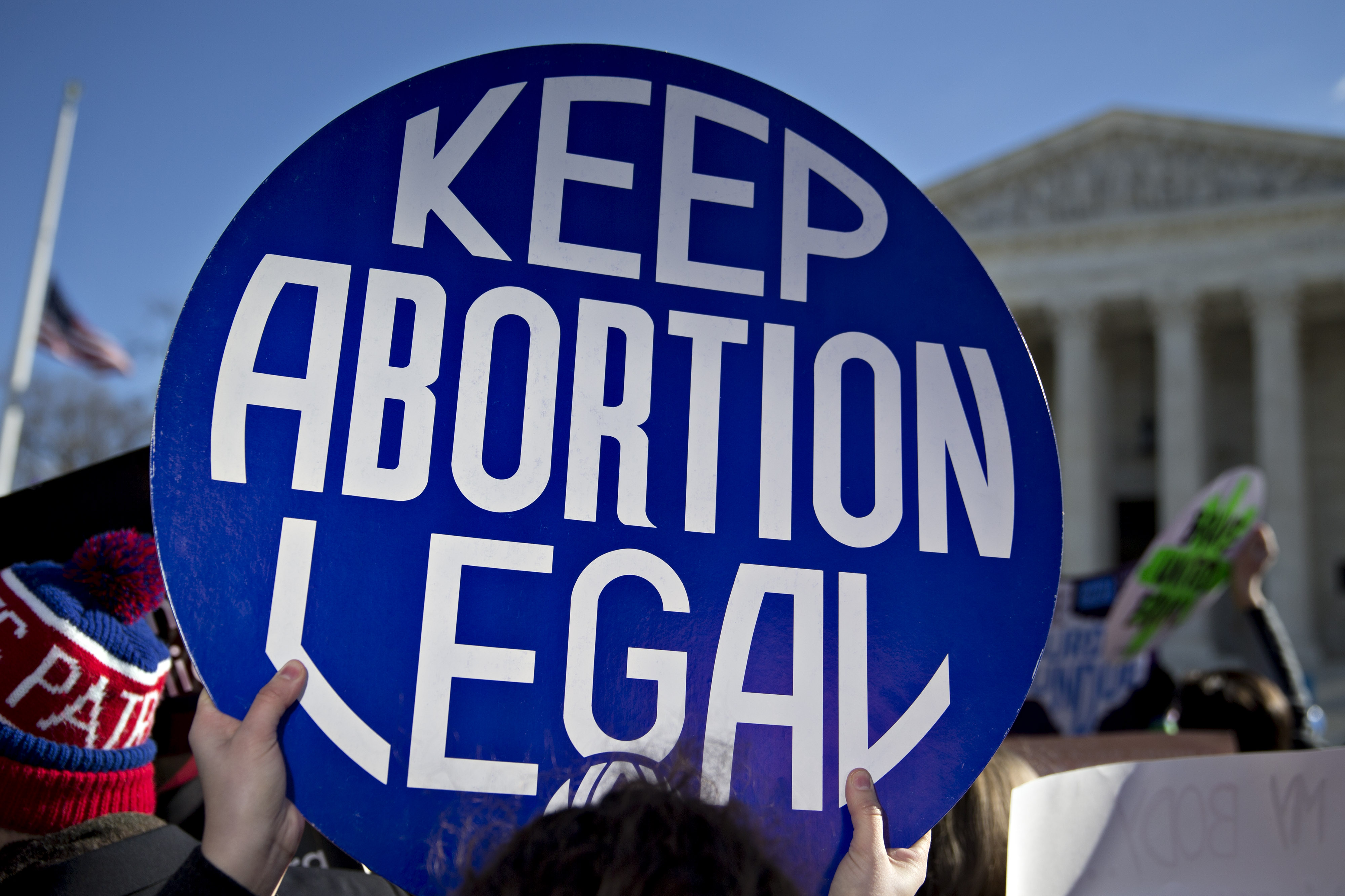 A demonstrator holds up a sign in support of abortion rights outside the U.S. Supreme Court in Washington, D.C., U.S., on Wednesday, March 2, 2016. Supreme Court justices clashed in their first abortion showdown in almost a decade as a pivotal justice suggested the court could stop short of a definitive ruling on a disputed Texas law regulating clinics. Photographer: Andrew Harrer/Bloomberg via Getty Images