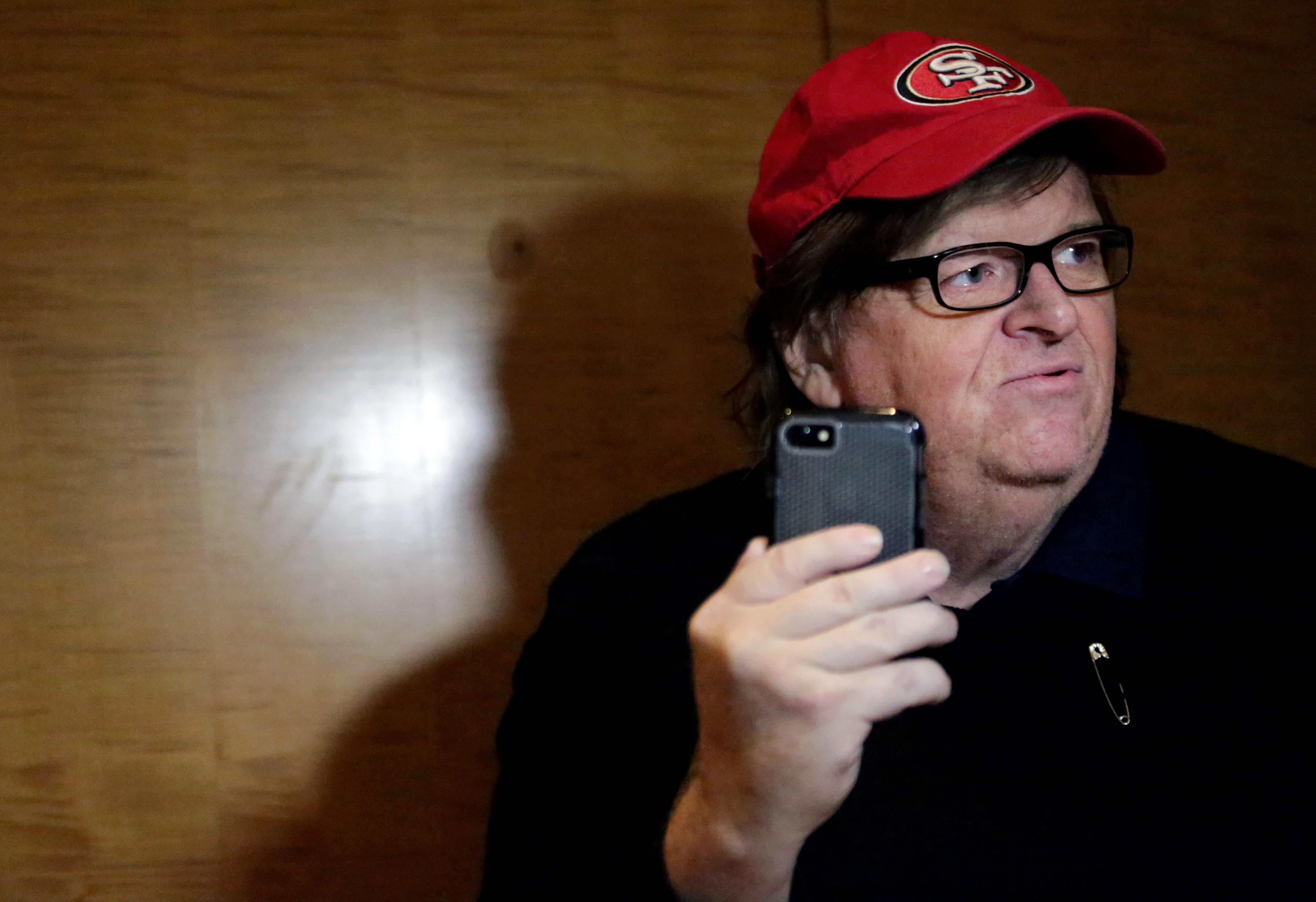 Filmmaker Michael Moore films himself with a smartphone at Trump Tower on November 12, 2016 in New York City.