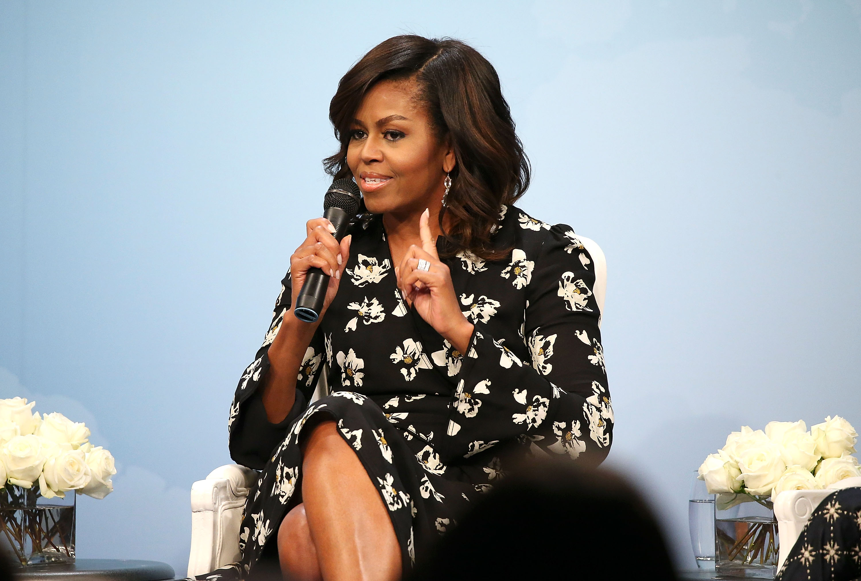 First Lady of the United States Michelle Obama speaks during a panel discussion at Glamour Hosts  A Brighter Future: A Global Conversation on Girls' Education  with First Lady Michelle Obama at The Newseum on October 11, 2016 in Washington, DC.  (Photo by Paul Morigi/Getty Images for Glamour)
