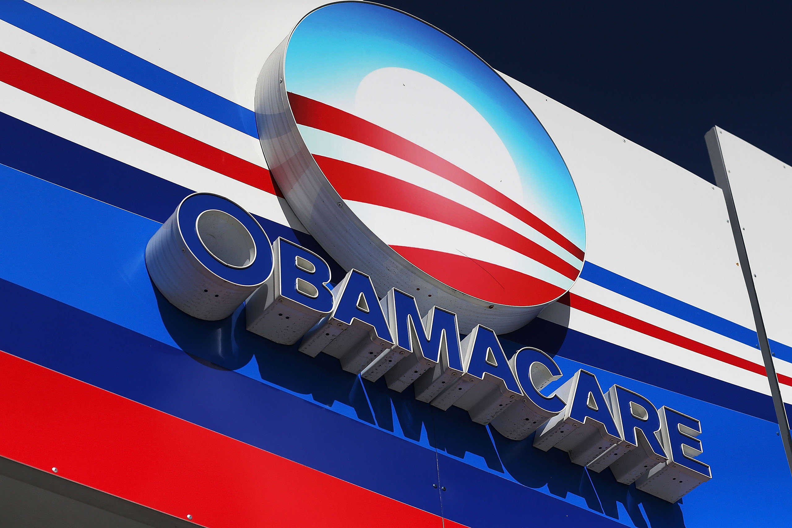 An Obamacare sign is seen on the UniVista Insurance company office on Dec. 15, 2015 in Miami, Florida.
