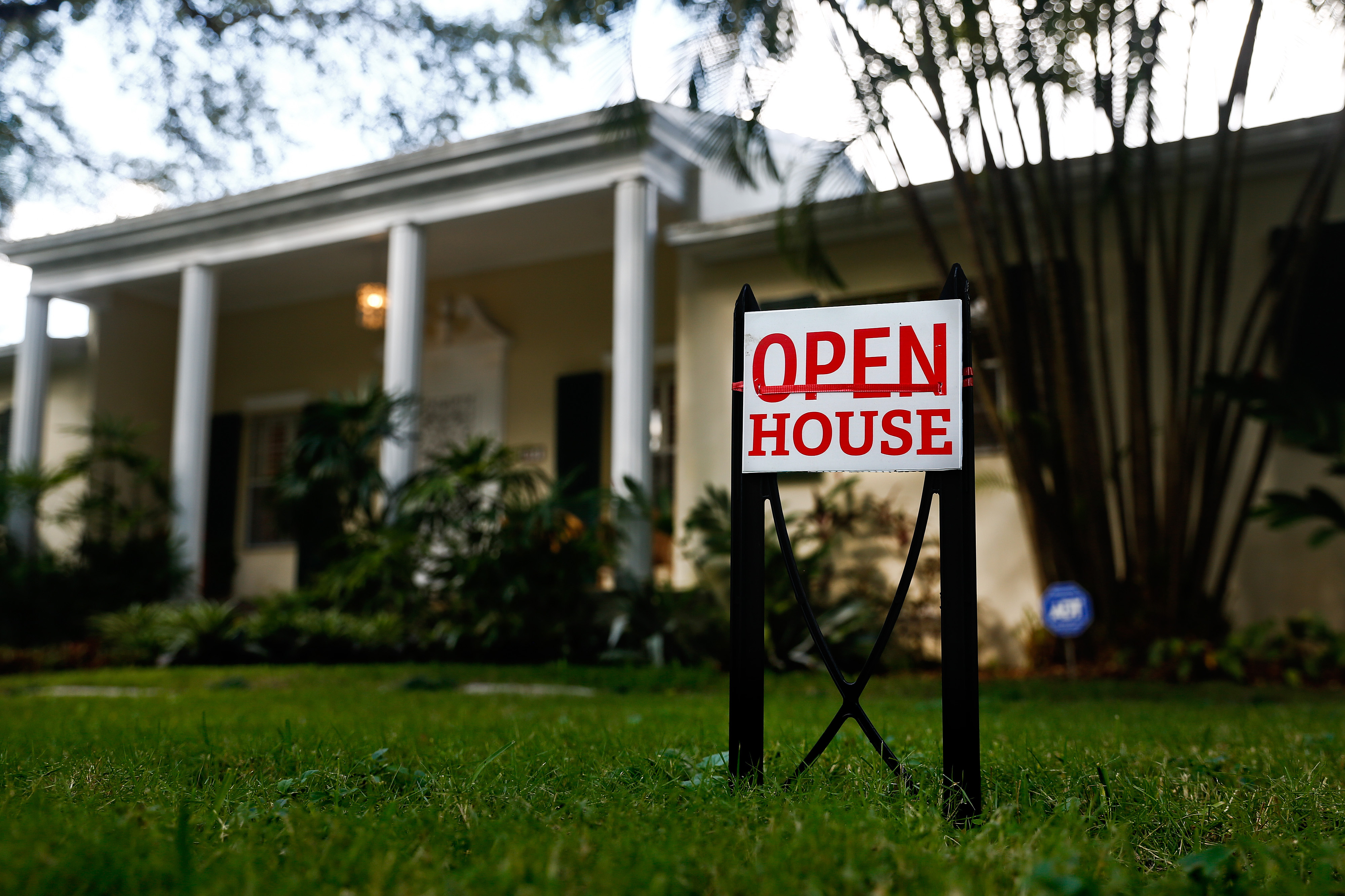 An  Open House  sign is displayed outside of a home for sale in Miami, Florida, U.S., on Nov. 19, 2016.