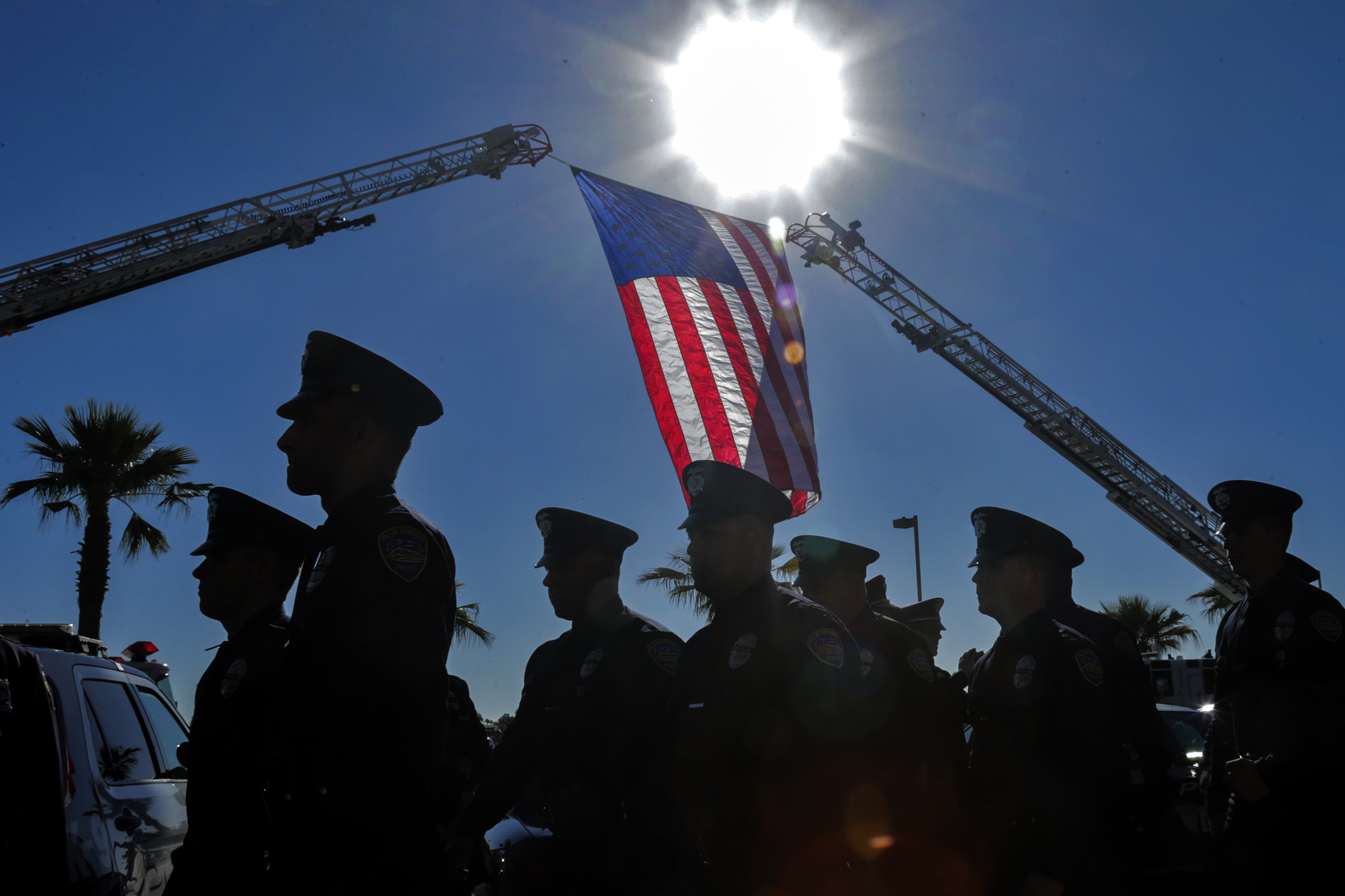 Palm Springs police officers march for memorial services for their colleague fallen Officers on Oct. 18, 2016 at Convention Center in Palm Springs.