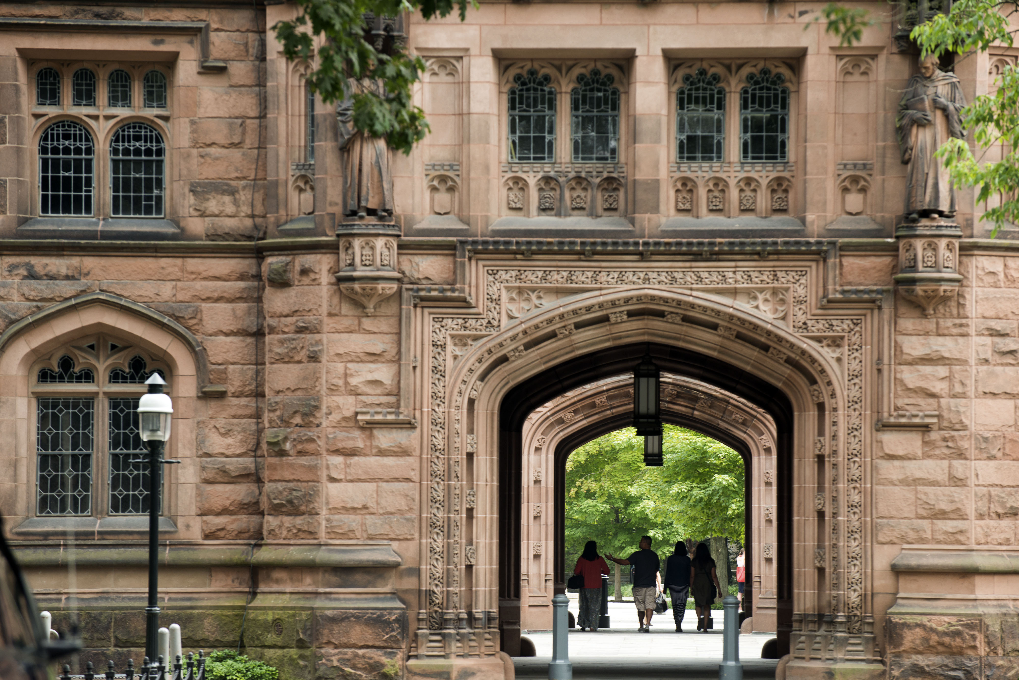 People walk on Princeton University campus in Princeton, New Jersey, U.S., on Friday, Aug. 30, 2013. Photographer: Craig Warga/Bloomberg via Getty Images