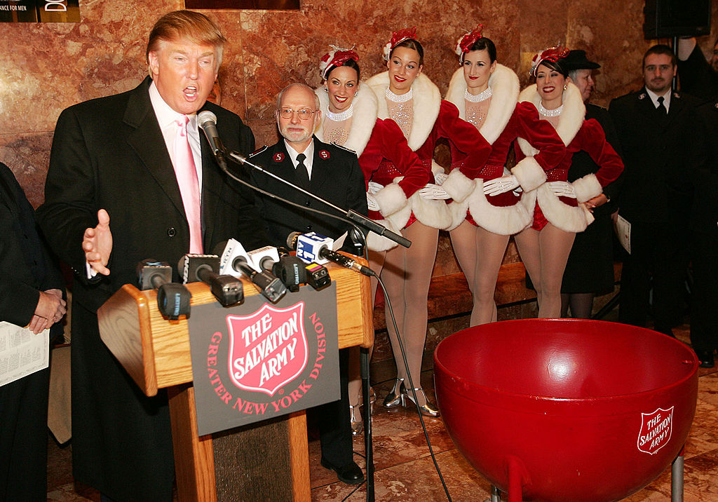 The Radio City Rockettes listen as Donald Trump speaks during a ceremony to help The Salvation Army kick off its annual Christmas kettle effort at the Trump Tower Atrium on Nov. 23, 2004 in New York City.