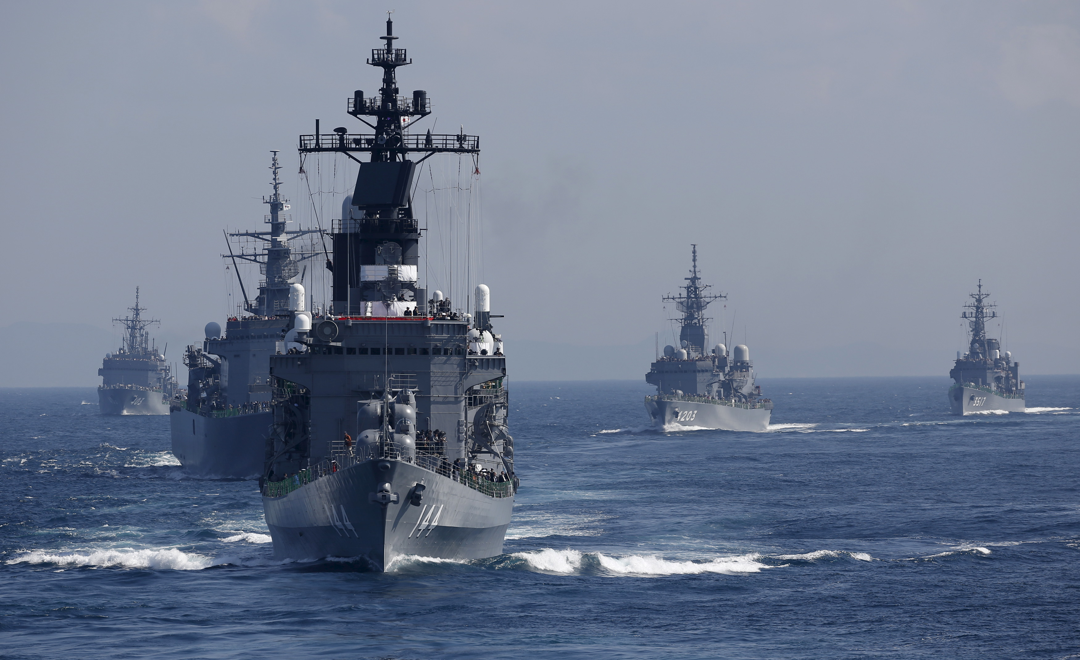 Japan's Maritime Self-Defense Force (JMSDF) destroyer Kurama (front), which is carrying Japan's Prime Minister Shinzo Abe, leads the MSDF fleet during its fleet review at Sagami Bay, off Yokosuka, south of Tokyo October 18, 2015.