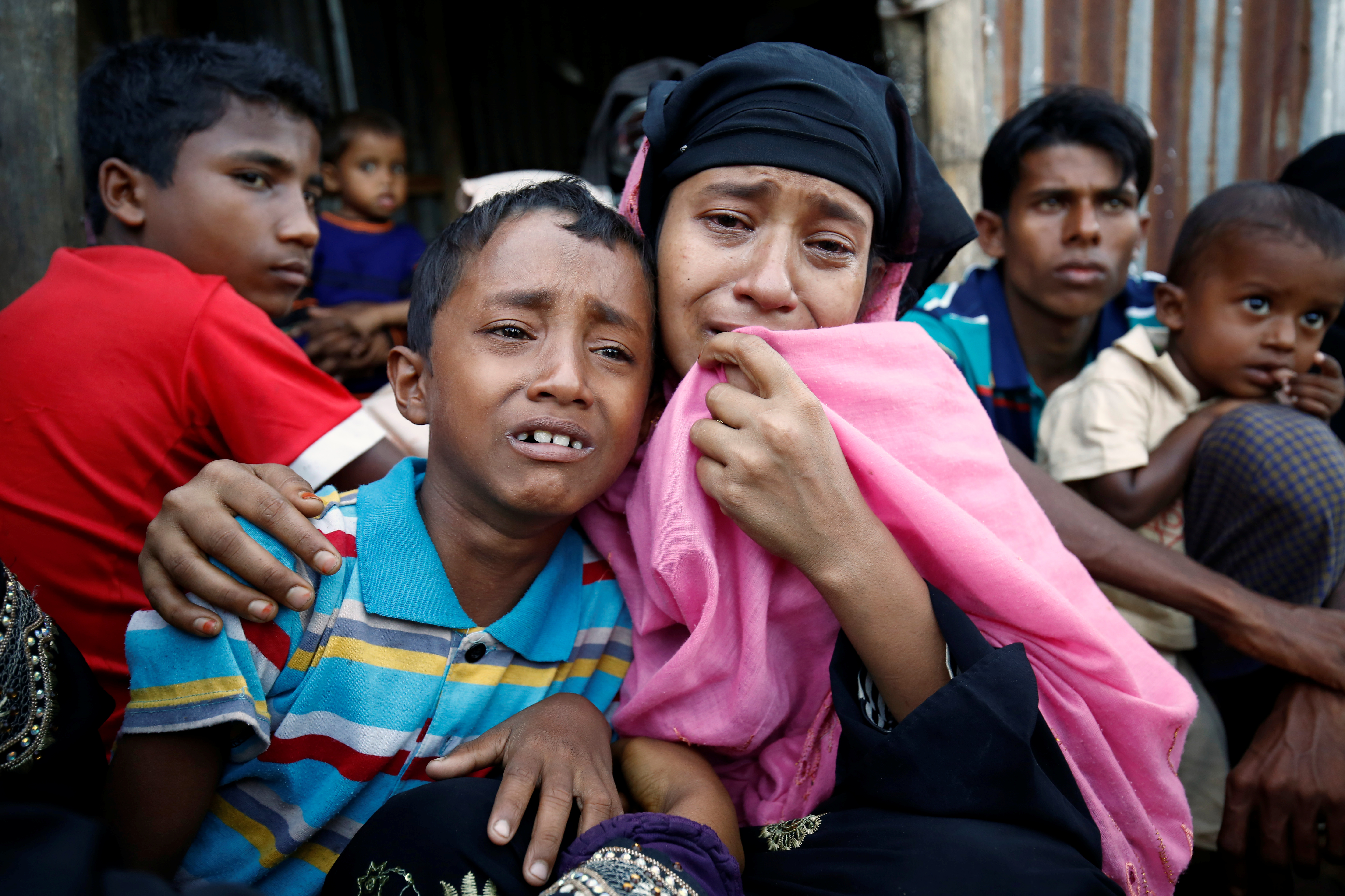 A Rohingya Muslim woman and her son cry after being caught by Border Guard Bangladesh (BGB) while illegally crossing at a border check point in Cox's Bazar, Bangladesh, on Nov. 21, 2016