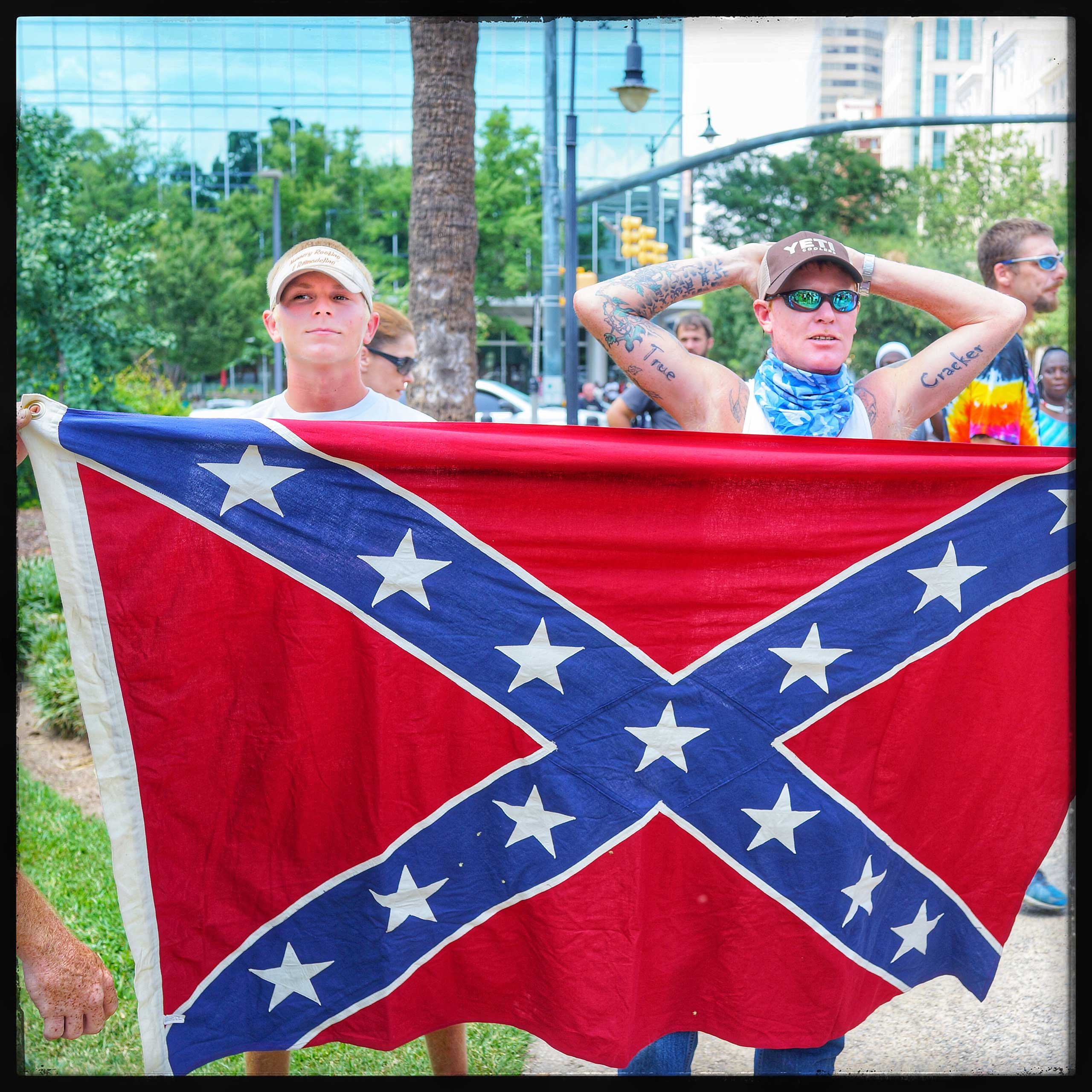 Young boys supporting the Ku Klux Klan stand in solidarity with the group outside of the South Carolina Capitol bulding to protest the taking down of the conferderate flag from the federal buildings in that state.