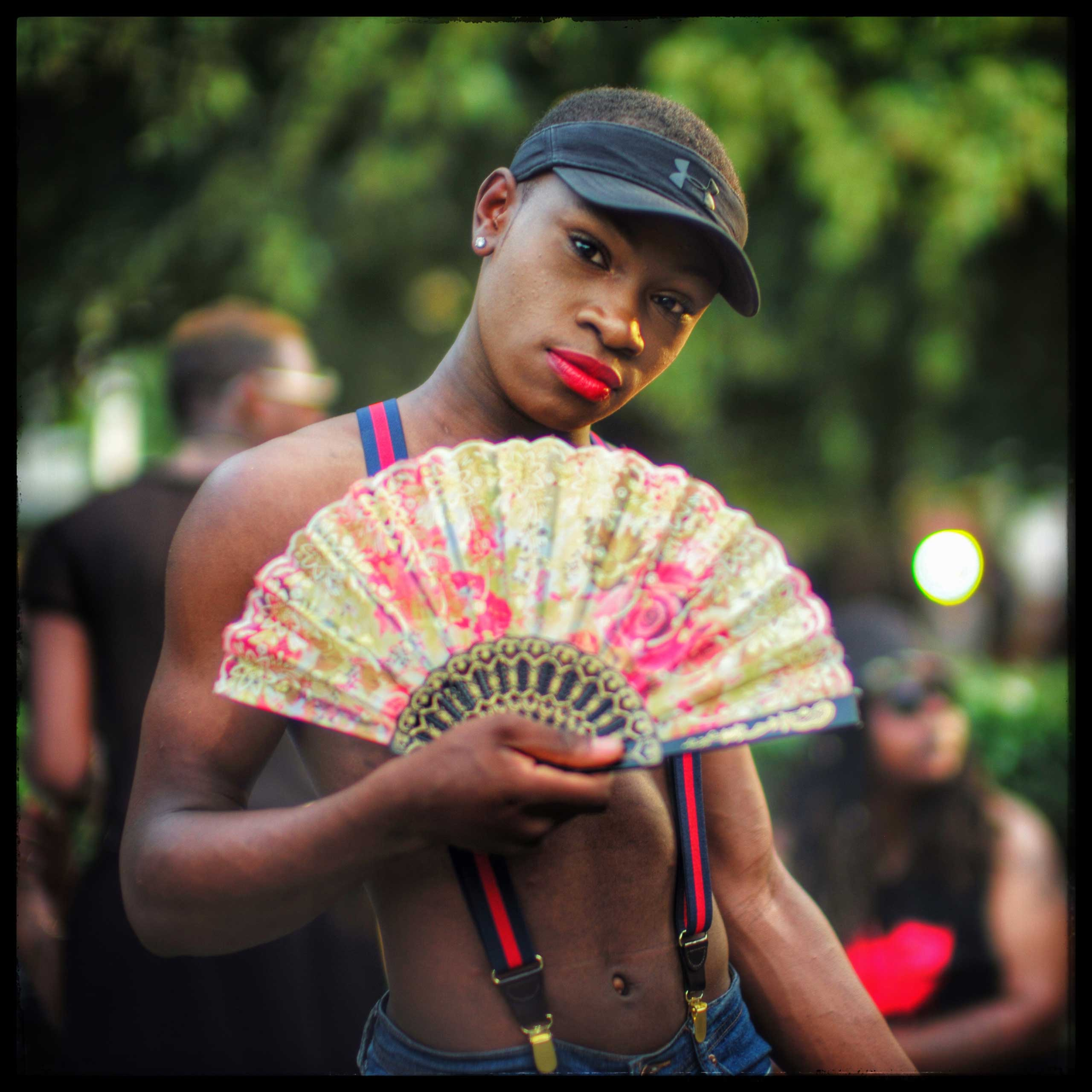 A D.C. Pride goer poses for a photograph before inviting me to come to Miami to photograph Miami Pride. Days later, a lone gunman opened fire inside The Pulse gay club in Orlando.