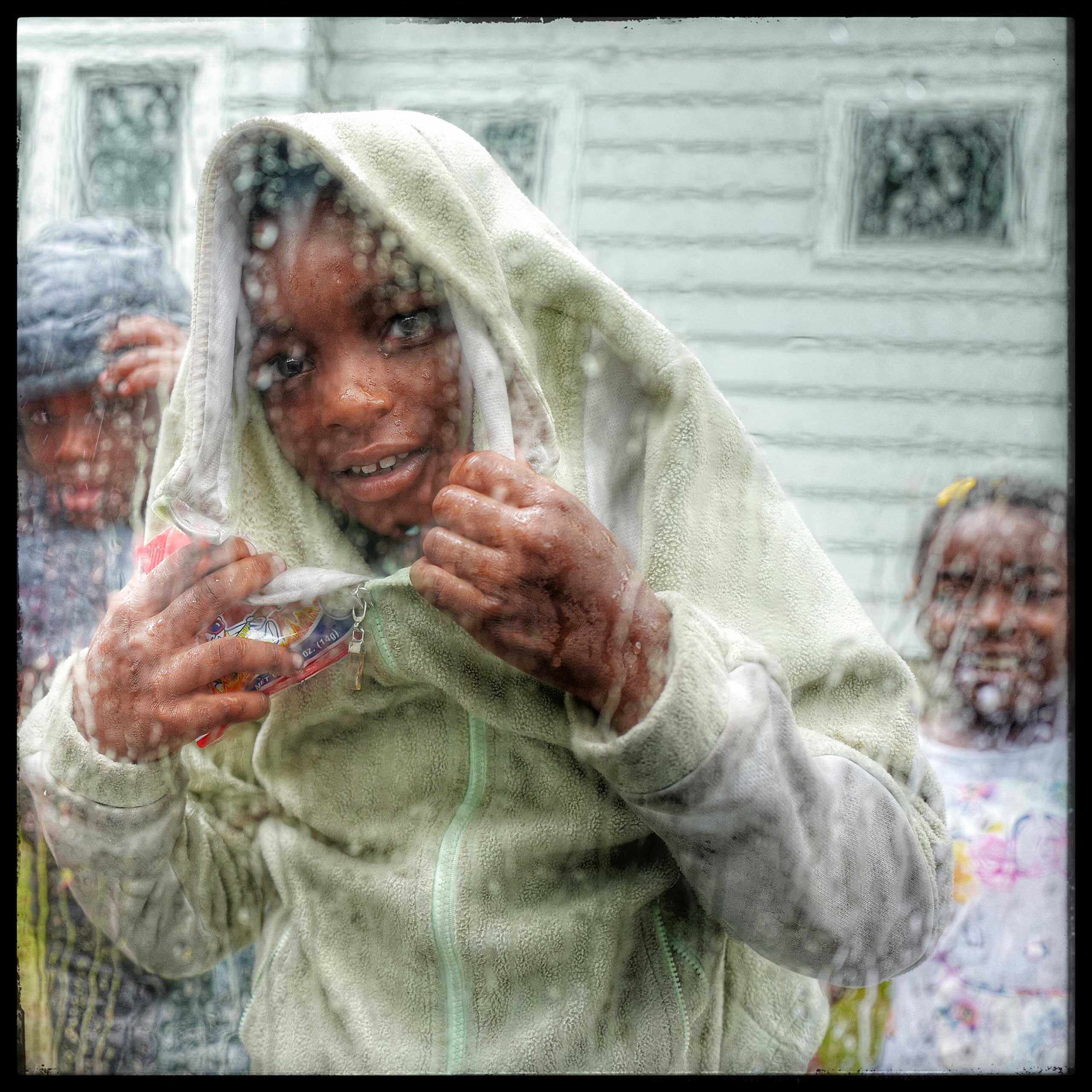 Children in Milwaukee, Winsconsin runs up to the car window to inquire if there was anything to eat.