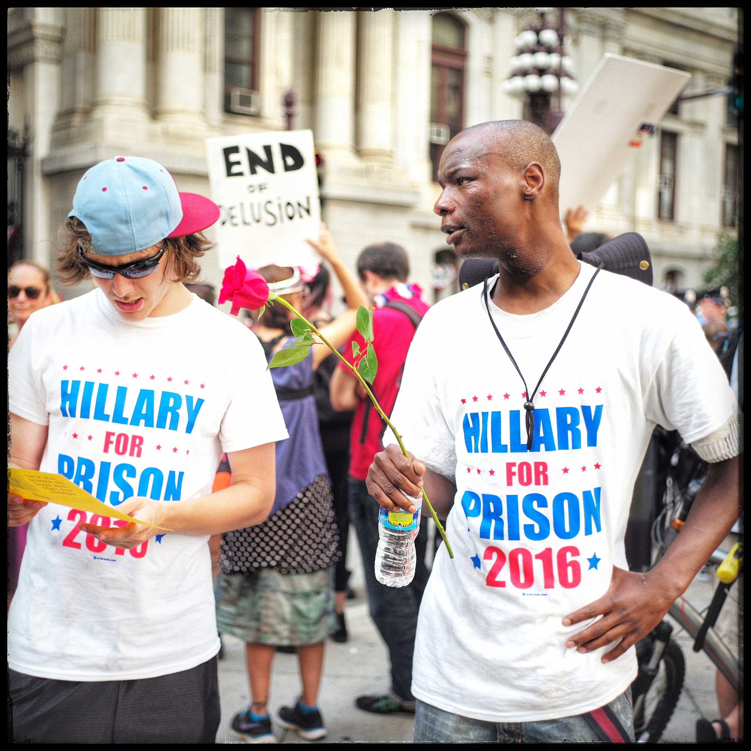 Two Bernie supporters, discuss which of the police officers they were going to give their last rose to. They were talking at the Democratic National Convention which was held in Philadelphia recently.