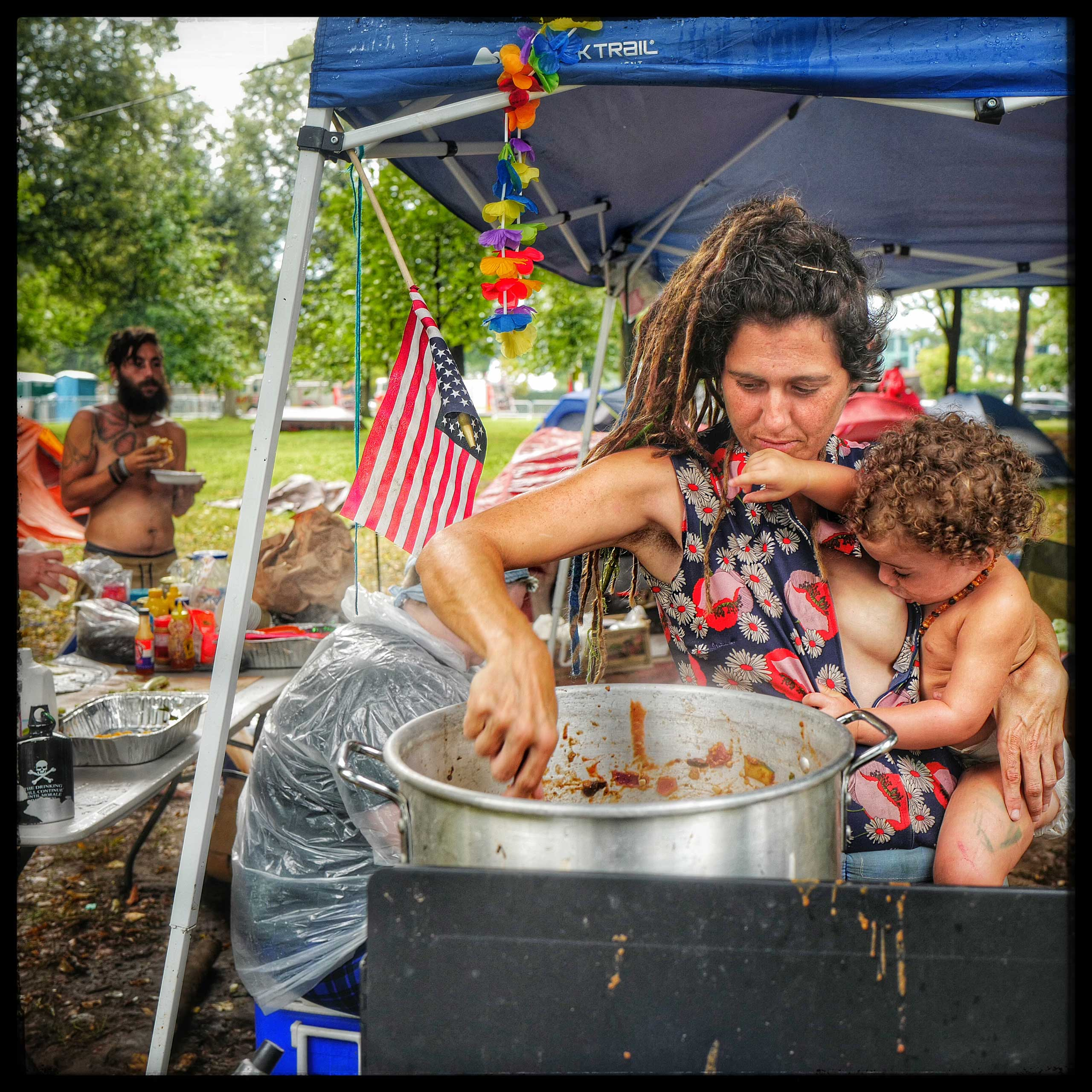 Stacey and her daughter Joy prepare a pot of zucchini, tomatoes and squash for protestors at the Democratic National Convention that was held in Philadelphia.