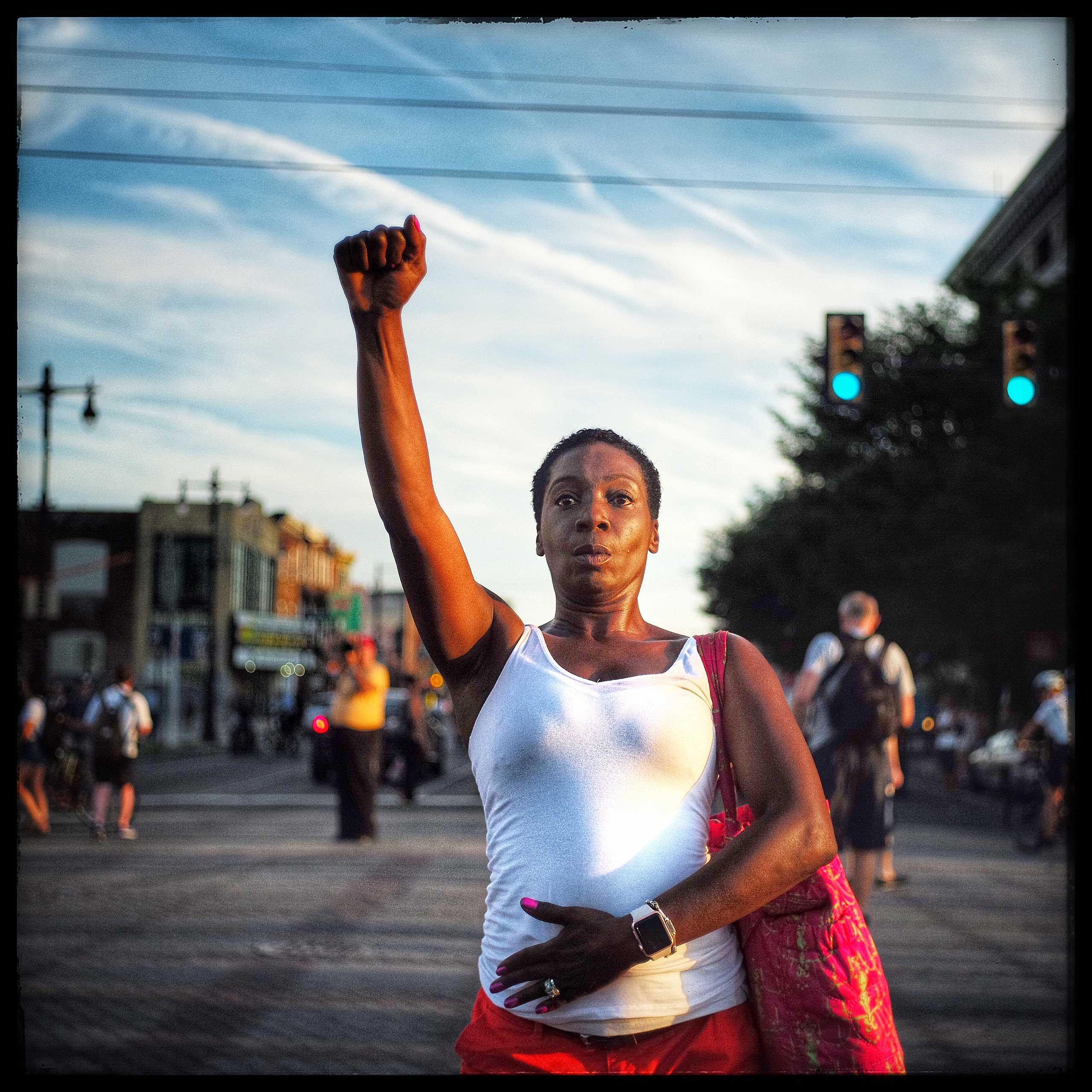 A lone protestor pauses to stop and salute other protestors on their way to the Democratic National Convention which was held in Philadelphia, Pennsylvania.