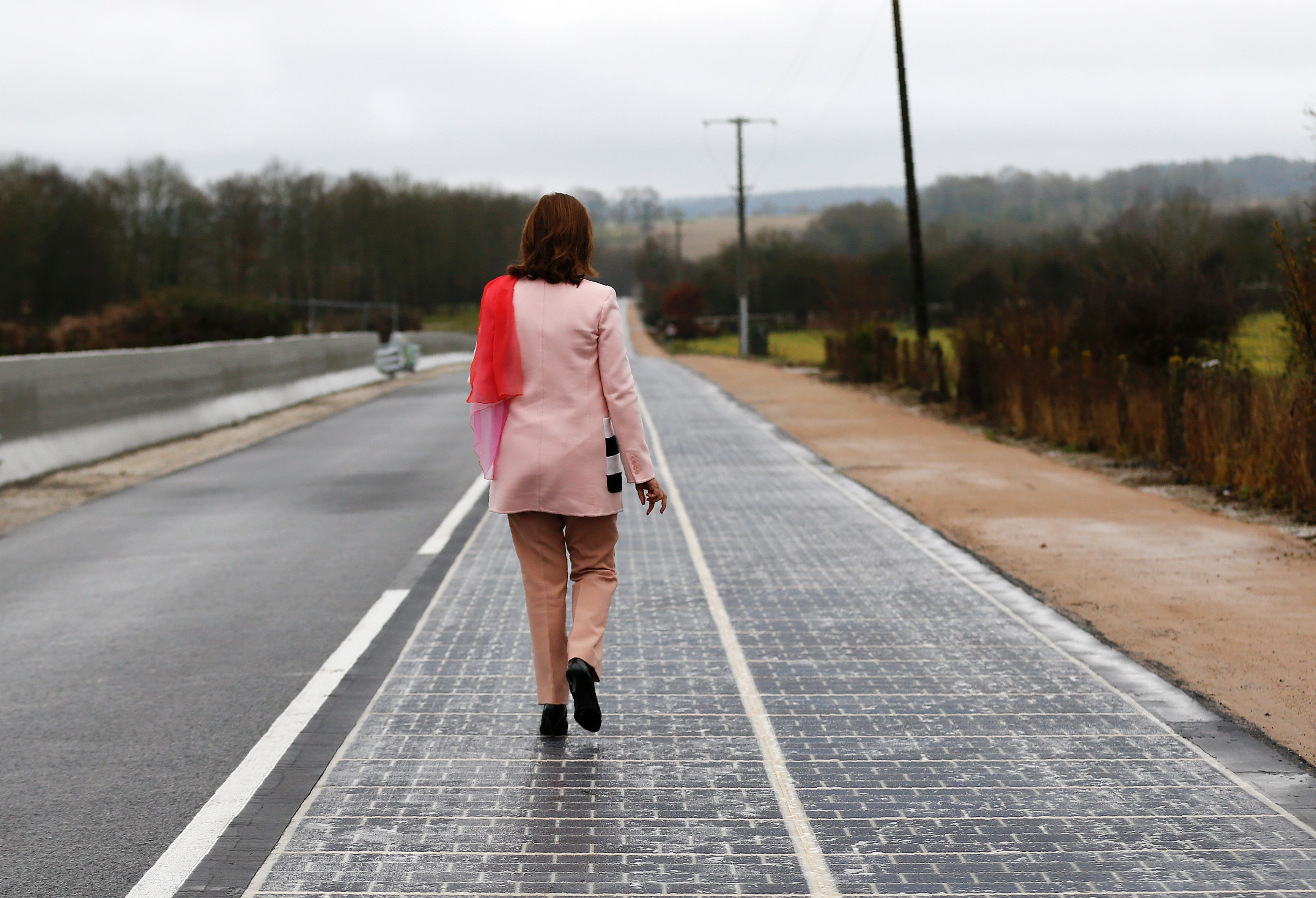 French Minister for Ecology, Sustainable Development and Energy Segolene Royal walks on a solar panel road during its inauguration in Tourouvre, France.