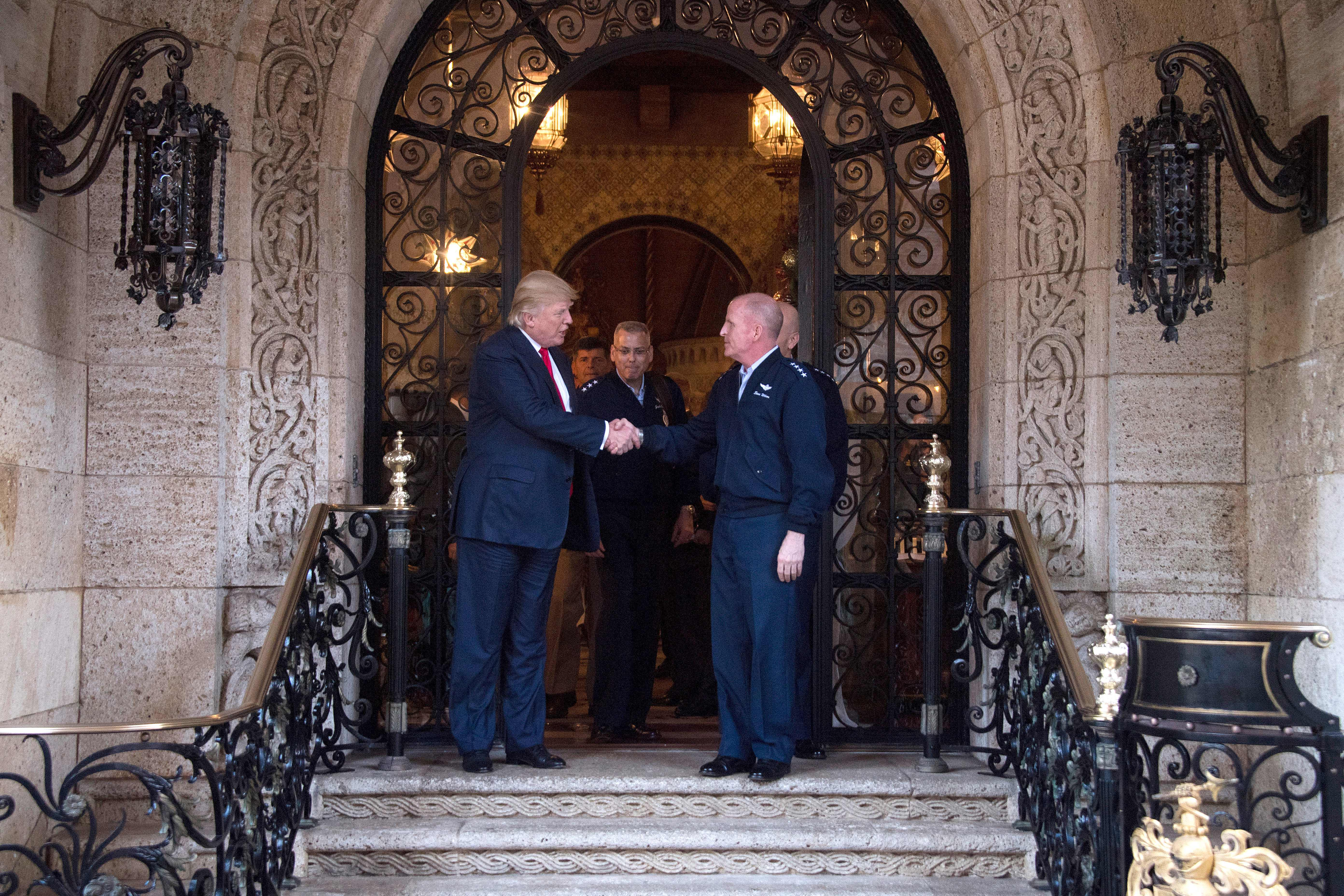 President-elect Donald Trump shakes hands with military leadership following meetings at Mar-a-Lago in Palm Beach, Florida, on Dec. 21, 2016.