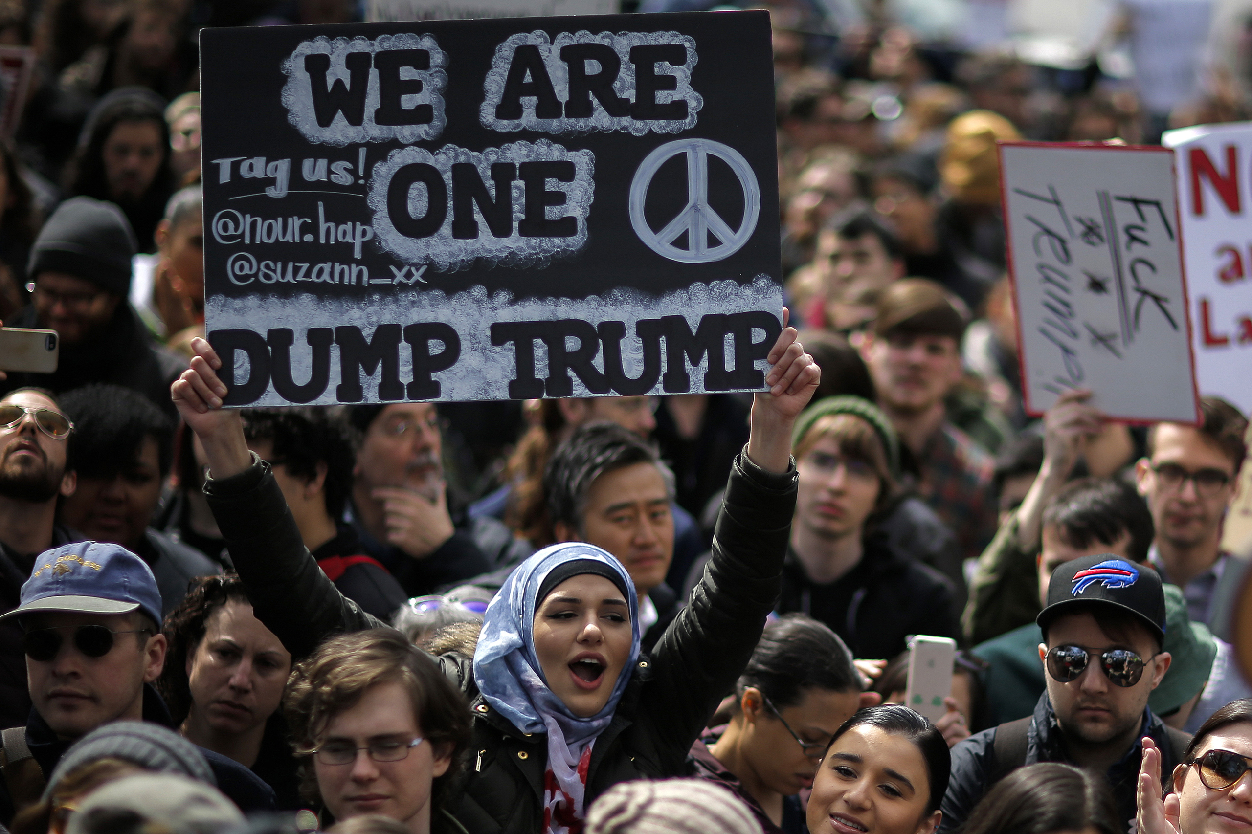 People take part in a protest against Republican presidential candidate Donald Trump in New York City, on March 19, 2016.