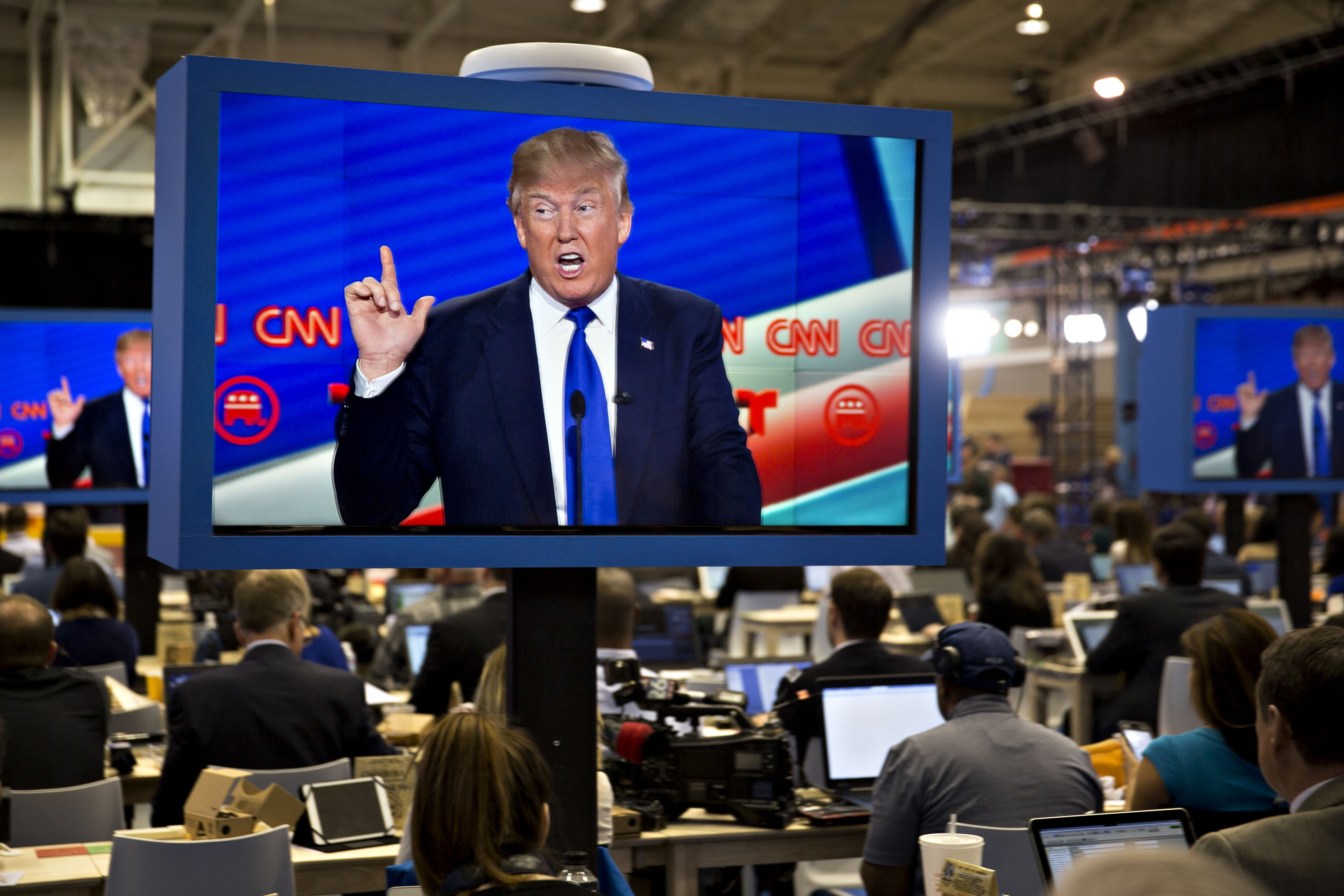 Donald Trump is seen speaking on a television screen in the filing center during the Republican presidential primary candidate debate sponsored by CNN and Telemundo at the University of Houston in Houston on  Feb. 25, 2016.