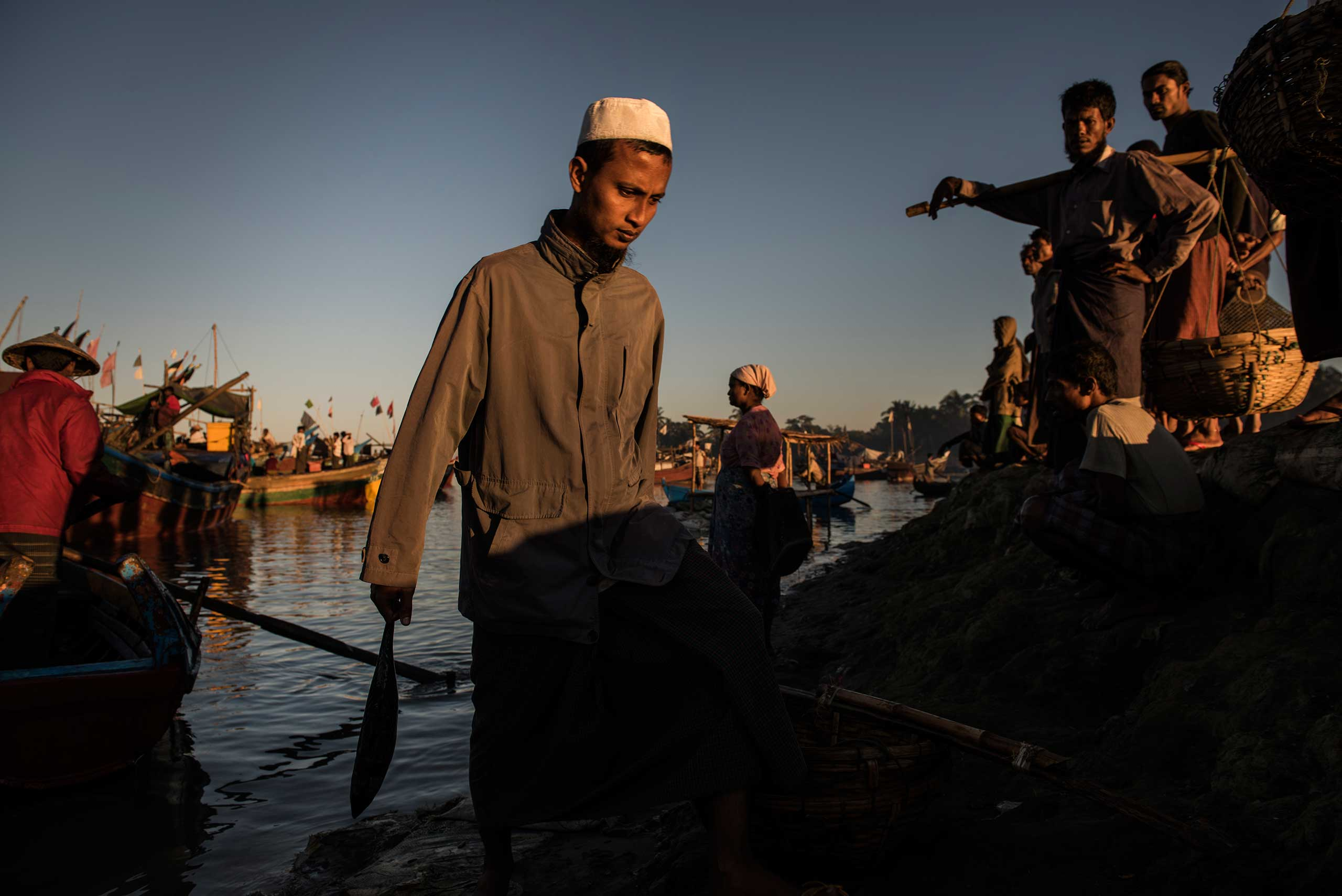 Rohingya fishermen arrive with fresh fish at the Thay Chaung fishing port in the Thay Chaung camp for internally displaced near Sittwe, in Myanmar, Nov. 24, 2015.  Every morning, dozens of fishermen arrive at the port after having been at sea from anywhere from a few hours to several days. Fishing is one of the main means for the Rohingya to support themselves and their families.