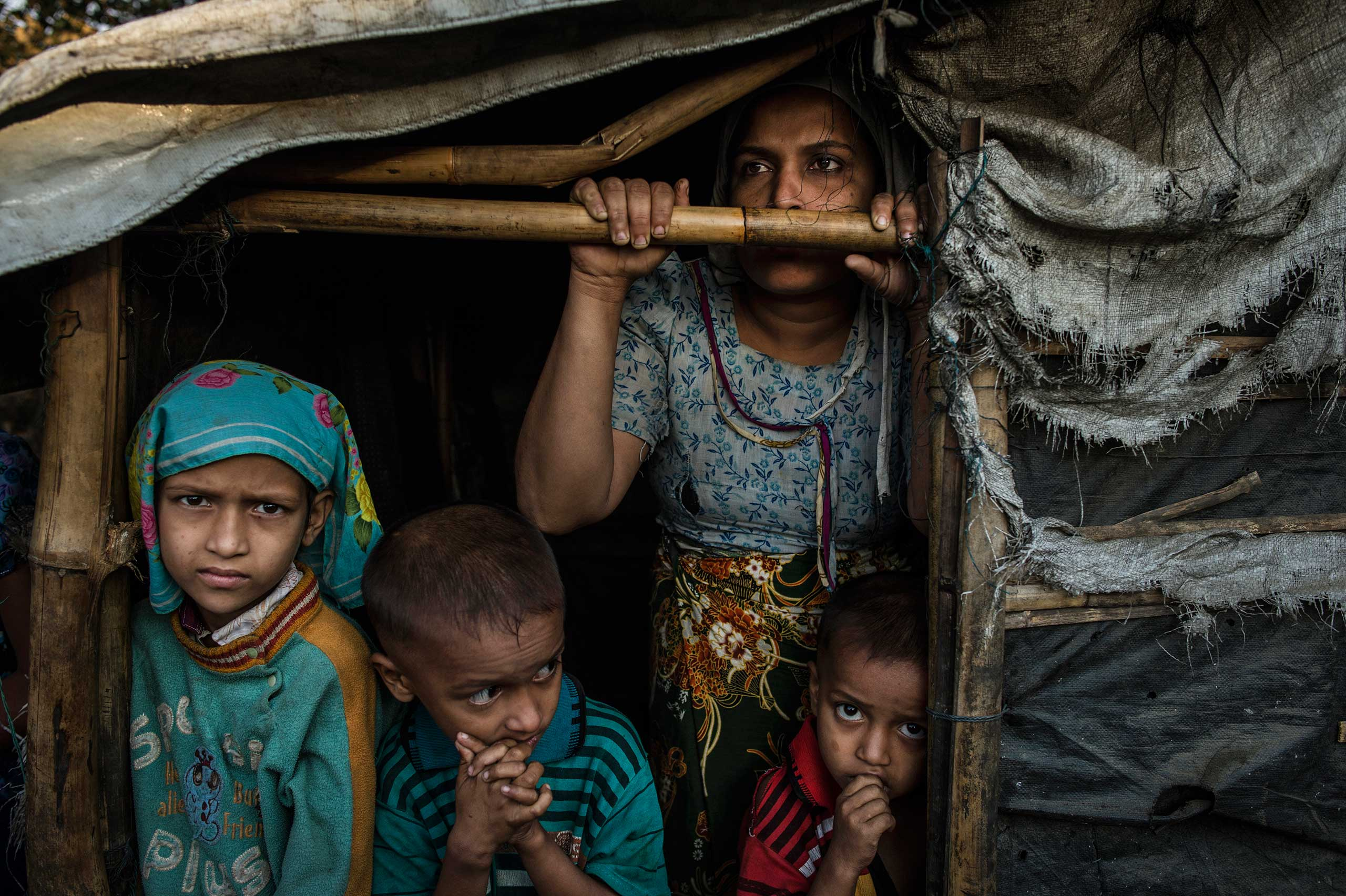 A Rohingya family, Burmese Muslims, live in the Thay Chaung camp for the Internally Displaced outside of Sittwe, which houses nearly 3000 people, Nov. 23, 2015.  The mother, pictured here, claimed all her children were malnourished, but because of the lack of medical professionals in the area, it was impossible to confirm.