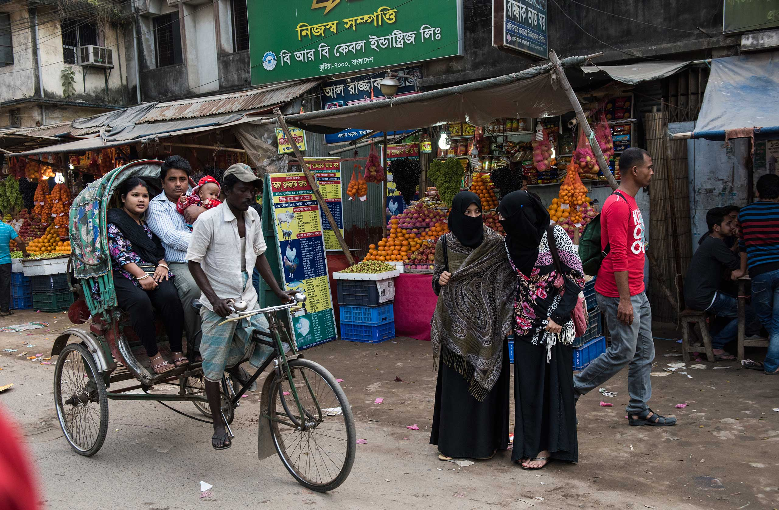 Rohingya men transport Bangldeshis through Cox's bazaar on cycle rickshaws. It is one of the few professions, along with fishing, working in ice-factories, and menial jobs in manual labor, that Rohingyas typically are able to work in Bangladesh, Jan. 16, 2016.