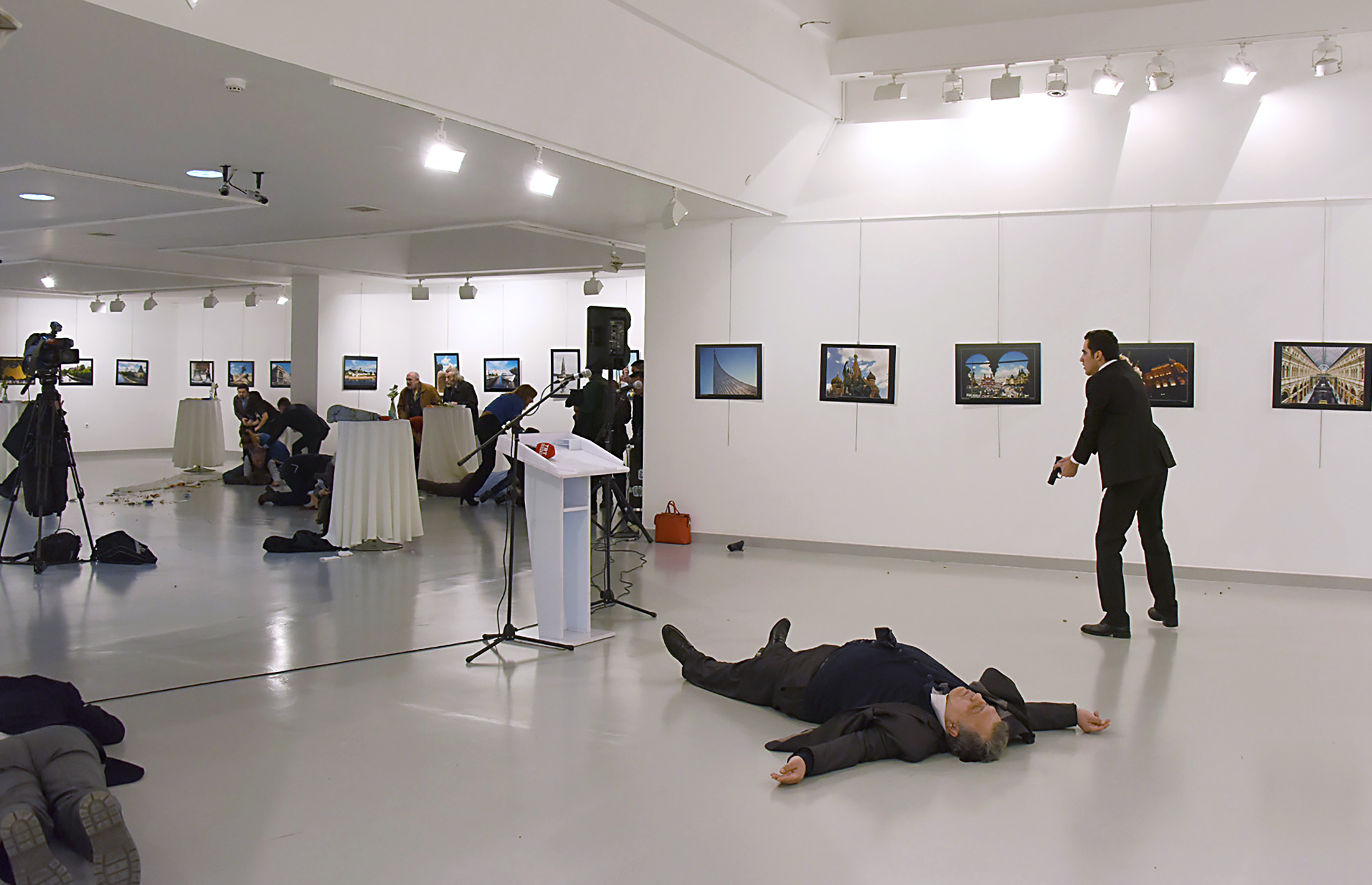 Andrey Karlov, Russia's ambassador to Turkey, lays on the ground after being shot by a gunman at a photo exhibit in Ankara on Dec. 19. He later died from his wounds.
