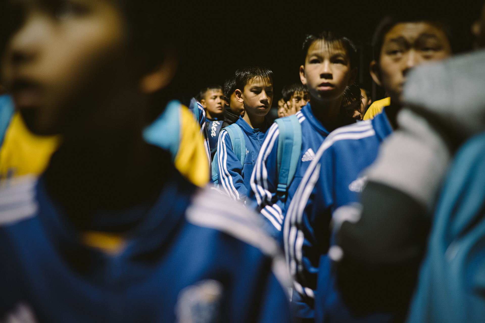 Twins Husan and Hasan, 11, are listening to a coach's speech after night training. March 17, 2016.