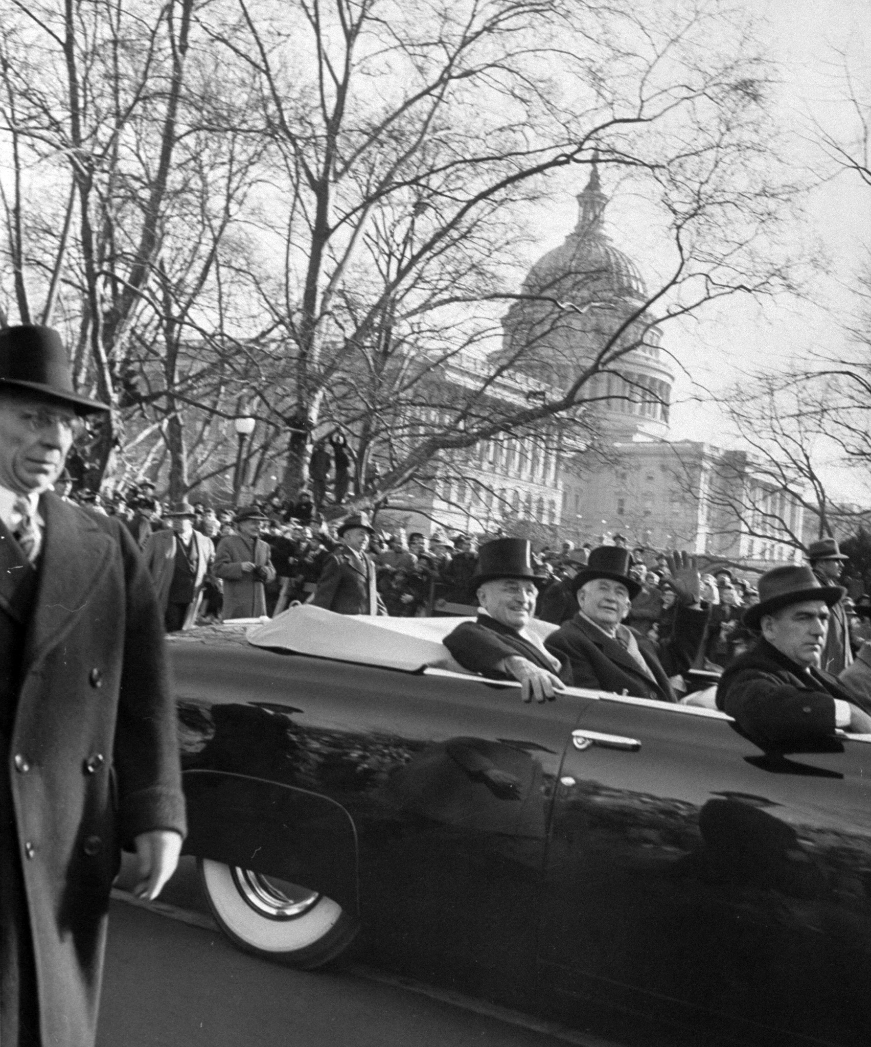 Harry S. Truman riding with Vice President Alben Barkley during the Presidential Inauguration parade, 1949.