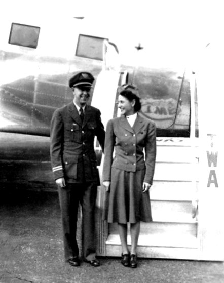 TWA air hostess Alice Getz poses with veteran Capt. Wayne Williams beside a DC-3. Both would be killed in the crash of TWA Flight 3.