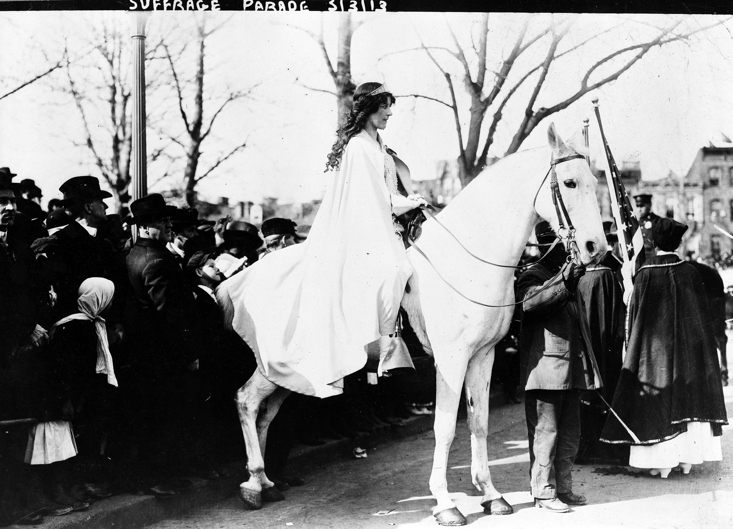 Inez Milholland Boissevain, wearing white cape, seated on white horse at the National American Woman Suffrage Association parade, March 3, 1913, Washington, D.C.