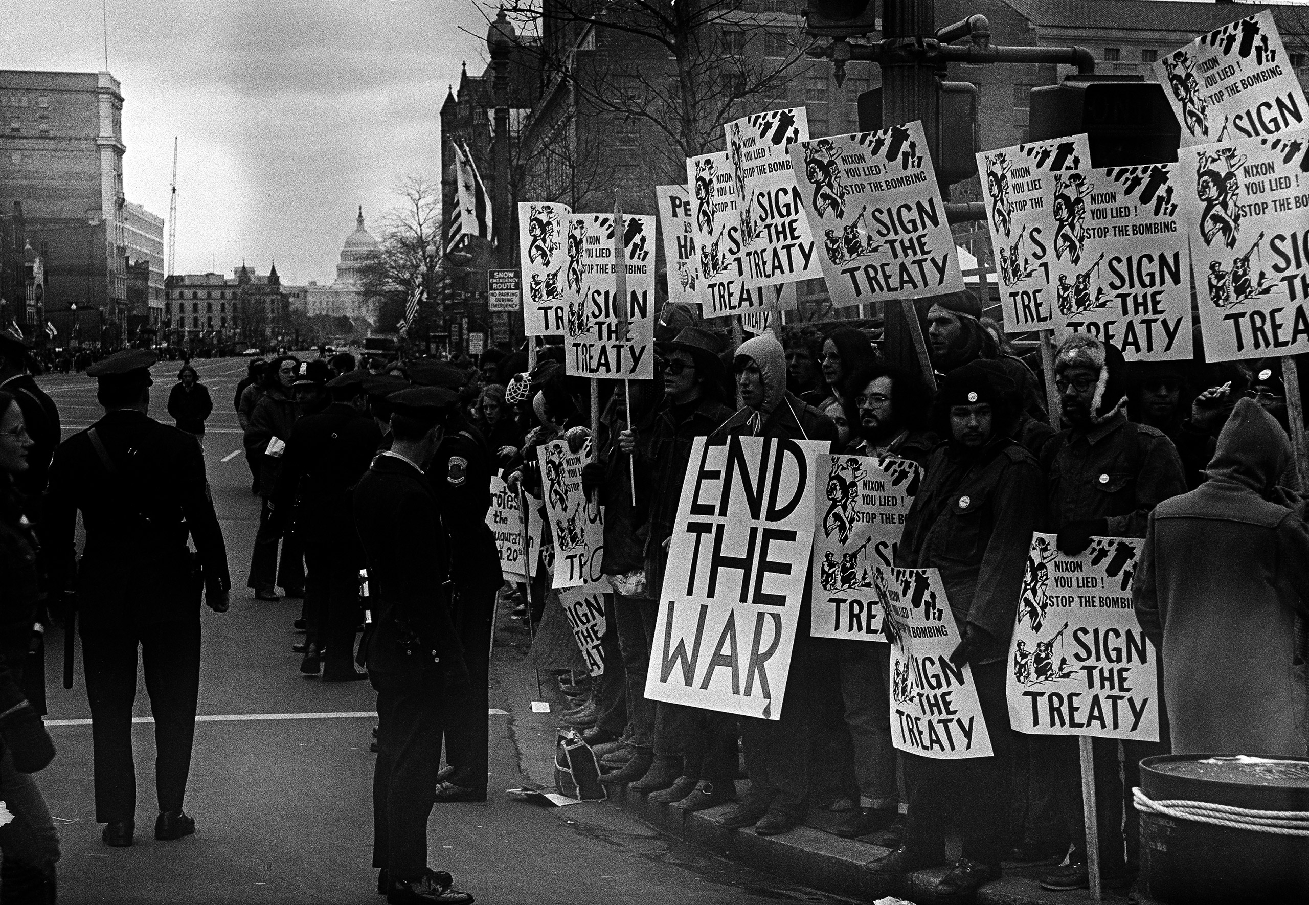 Police stand in front of group of antiwar demonstrators lined along Pennsylvania Avenue in Washington, D.C., Jan. 20, 1973, before the inauguration pf President Richard M. Nixon.