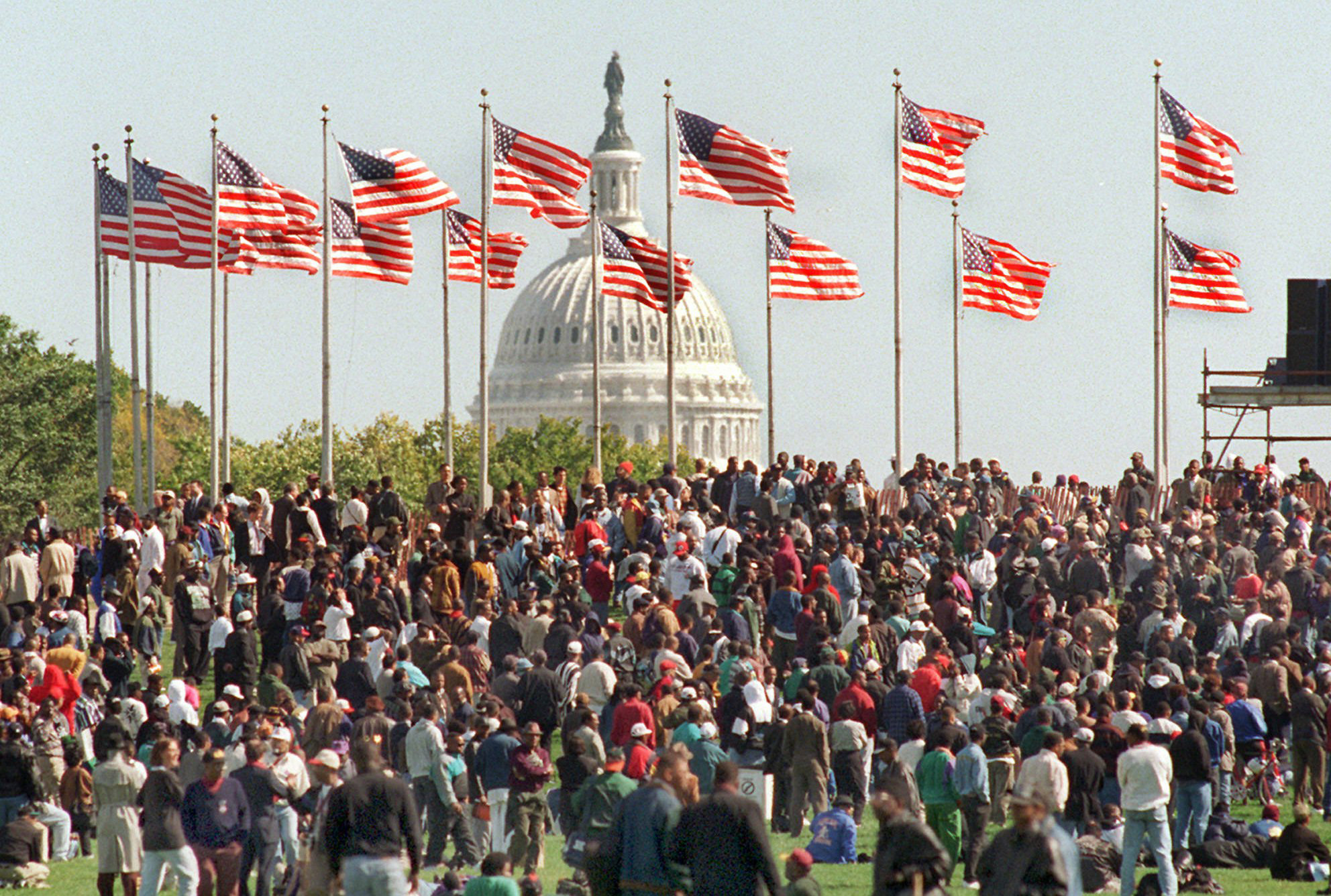With the Capitol in the background, participants in the Million Man March gather on the Washington Monument grounds Monday Oct. 16, 1995.