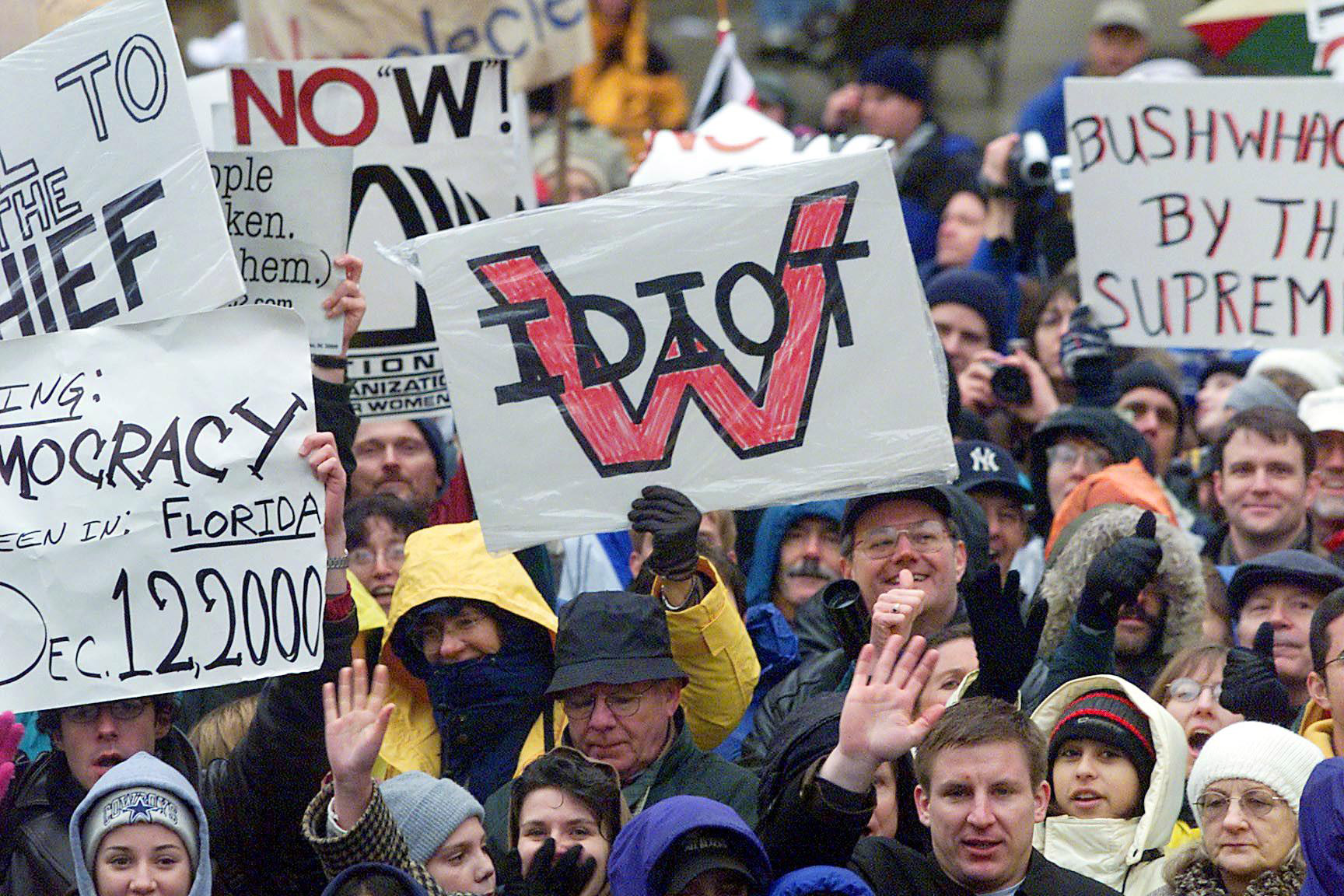 Demonstrators make their feelings known as they crowd along the George W. Bush inauguration parade route on Jan. 20, 2001, in Washington, D.C.
