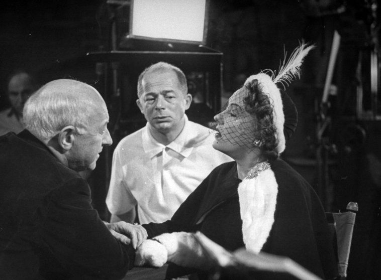 """Cecil B. DeMille, Billy Wilder and Gloria Swanson during the filming of """"Sunset Blvd.""""in 1949."""
