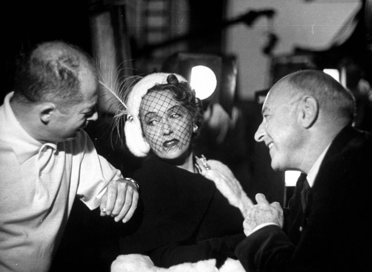 """Billy Wilder, Gloria Swanson and Cecil B. Demille during the filming of """"Sunset Blvd.""""in 1949."""