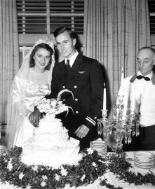 George and Barbara Bush cut their wedding cake, Rye, New York on Jan. 6, 1945.