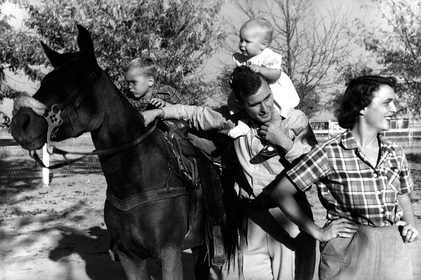 George H. W. Bush with his wife, Barbara with their children Pauline and George W. on horse in the yard of their Midland, Texas ranch, 1950.