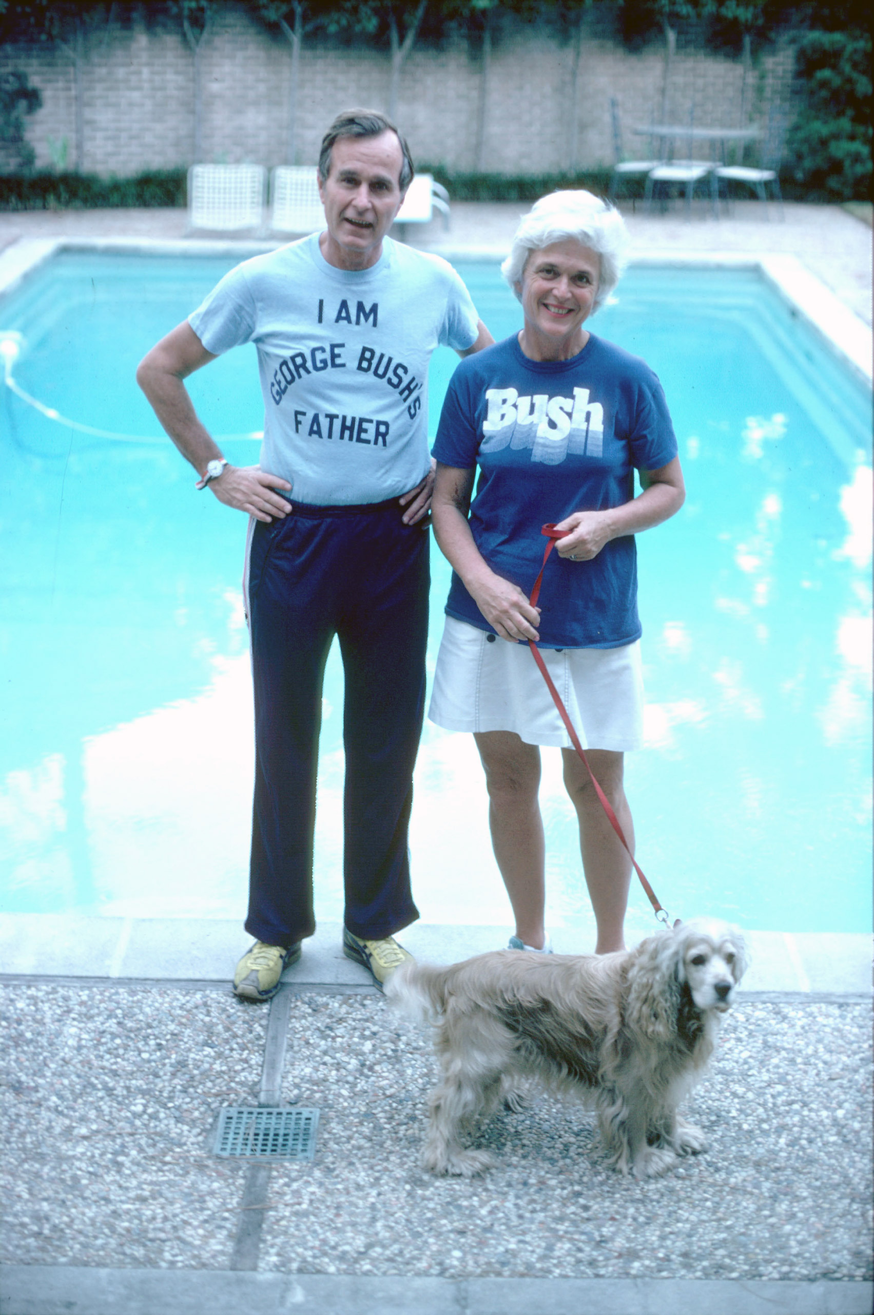 George H.W. Bush, wearing a t-shirt alluding to his son George W. Bush's run for Congress, stands with his wife Barbara in Nov. 1978.